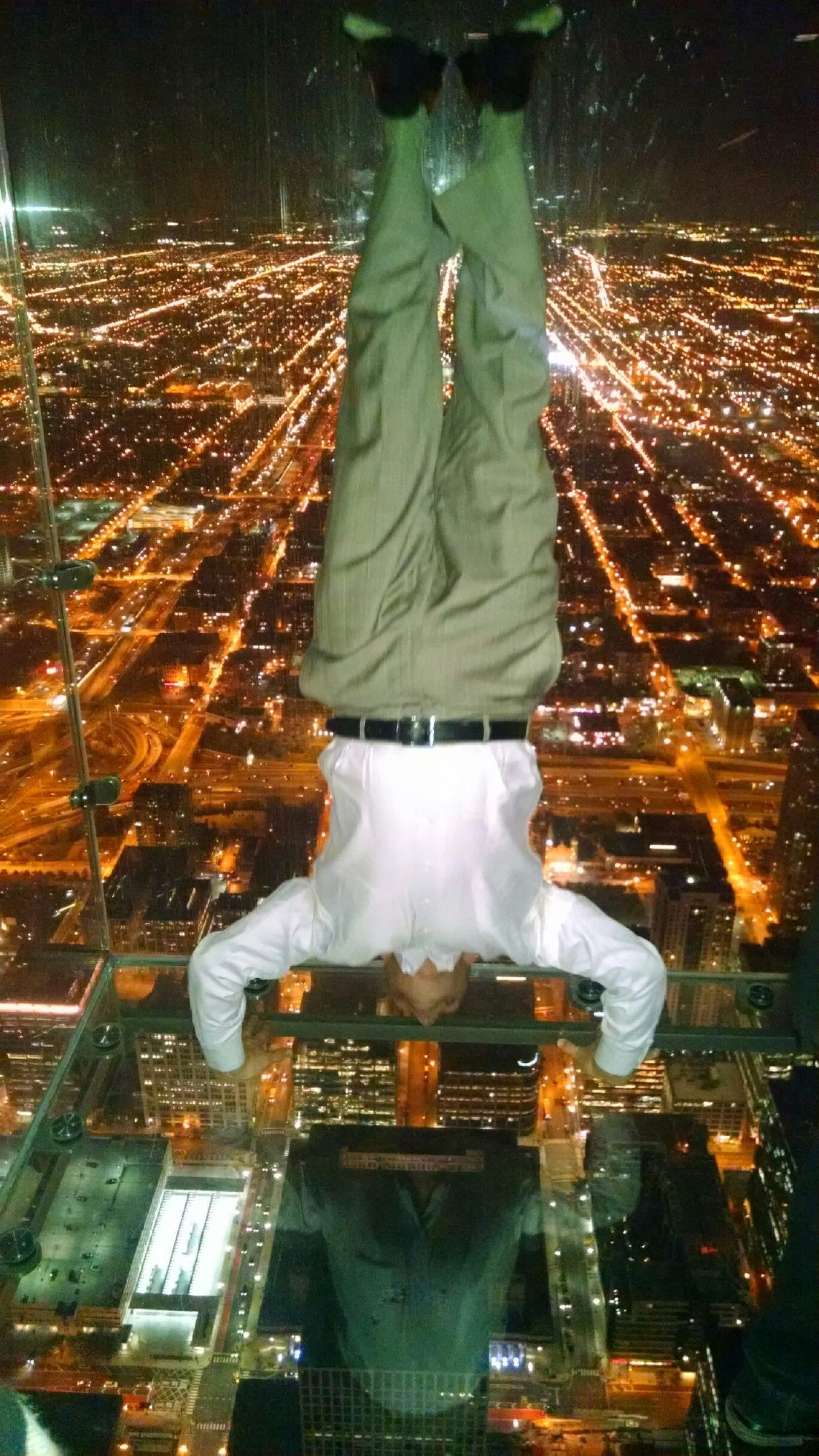 While many at the Monday night reception feared to tread out on the Willis Tower Ledge, Cliexie Media LLC Executive Director Tim Moore performed a handstand inside the glass box 1,353 up in the air.