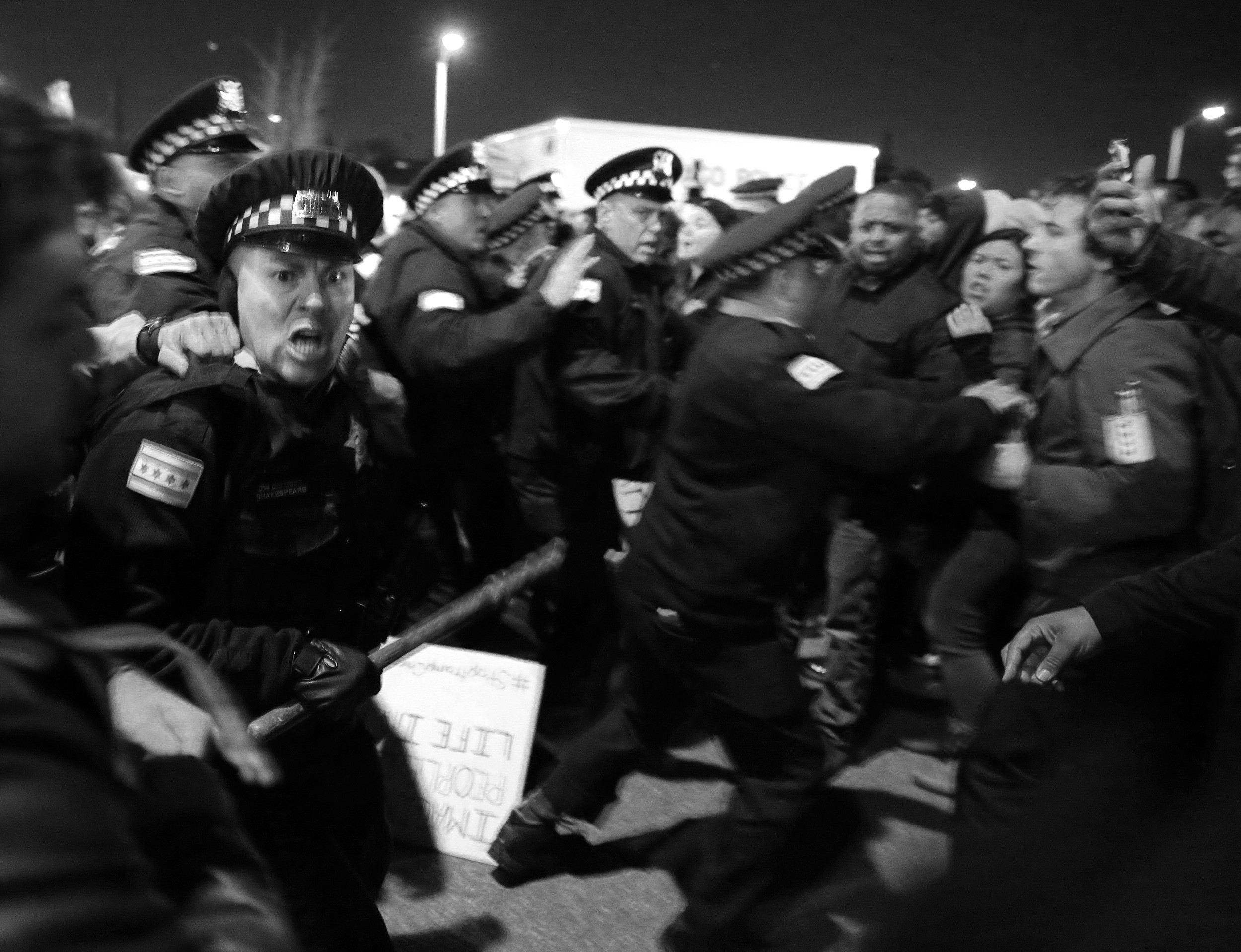 "Jonathon Miano of The Times in Munster, Ind., won first place for ""Protests for Laquan,"" a photo of a confrontation between Chicago police and protesters."