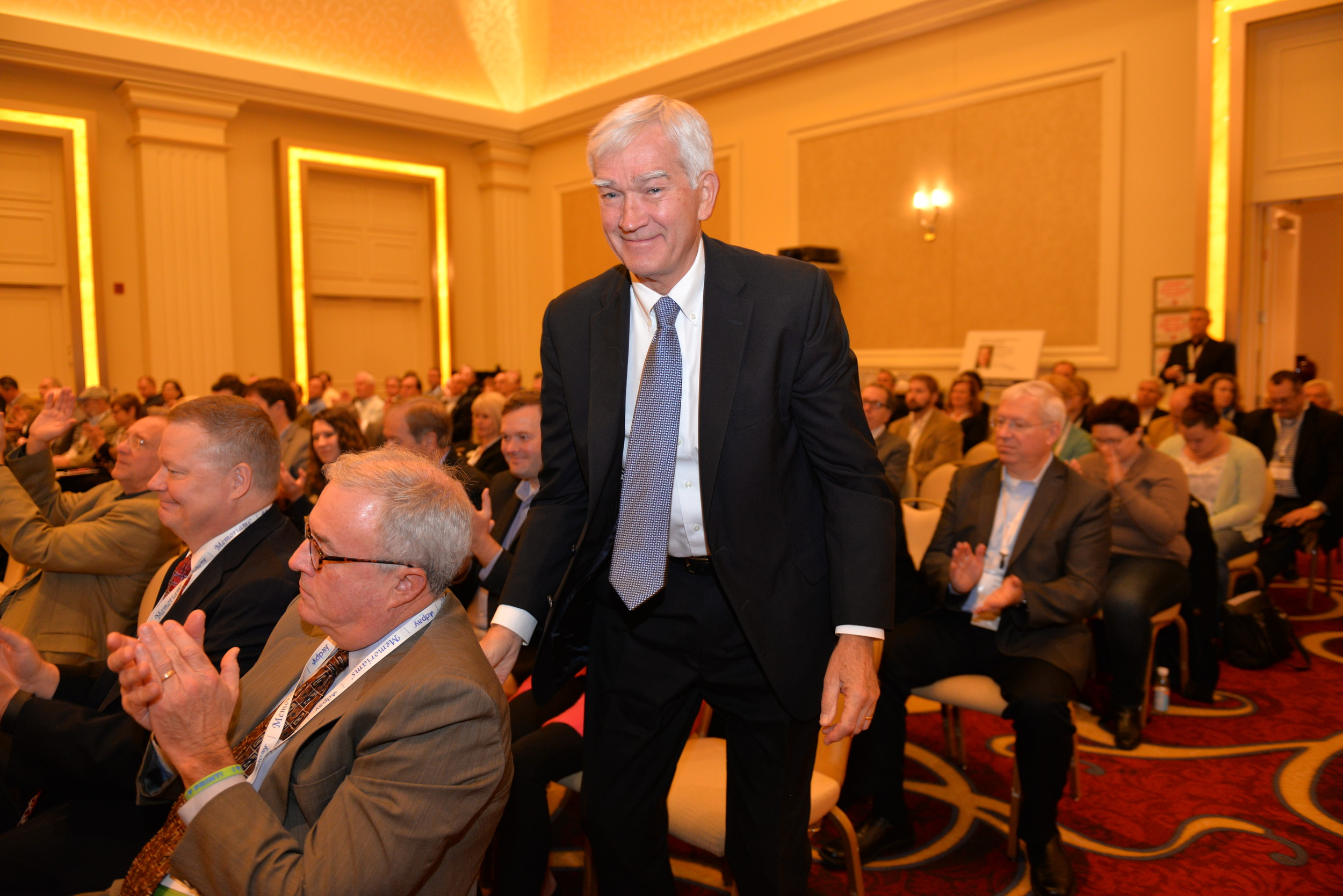 Tom Shaw rises from his seat at Inland's 2016 Annual Meeting to receive the Ralph D. Casey/Minnesota Award honoring industry figures who are agenda-setters bringing about change while exemplifying the best in journalism and community service. .