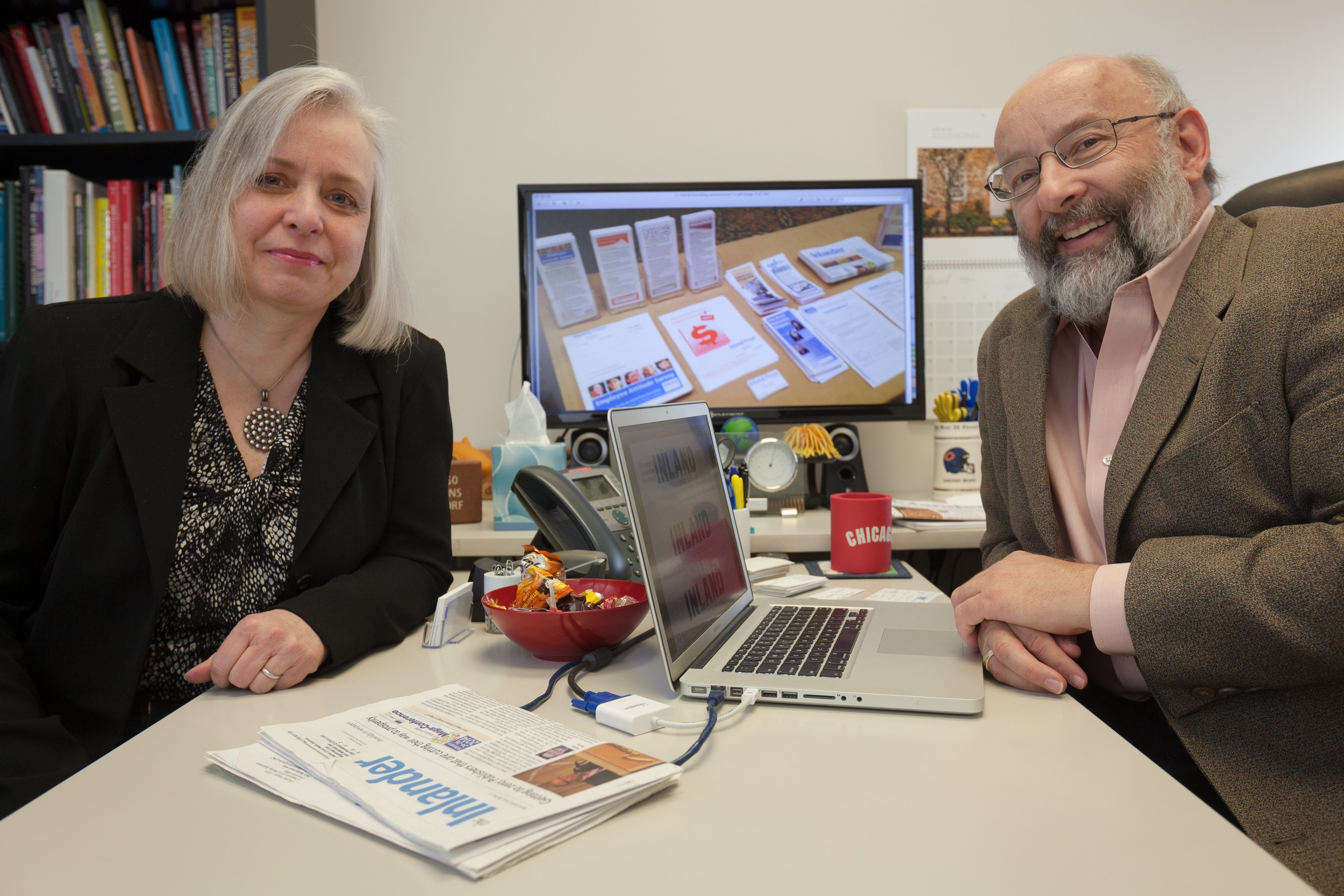 Lynn Rognsvoog and Bill Ostendorf working on a rebranding campaign for the Inland Press Association.