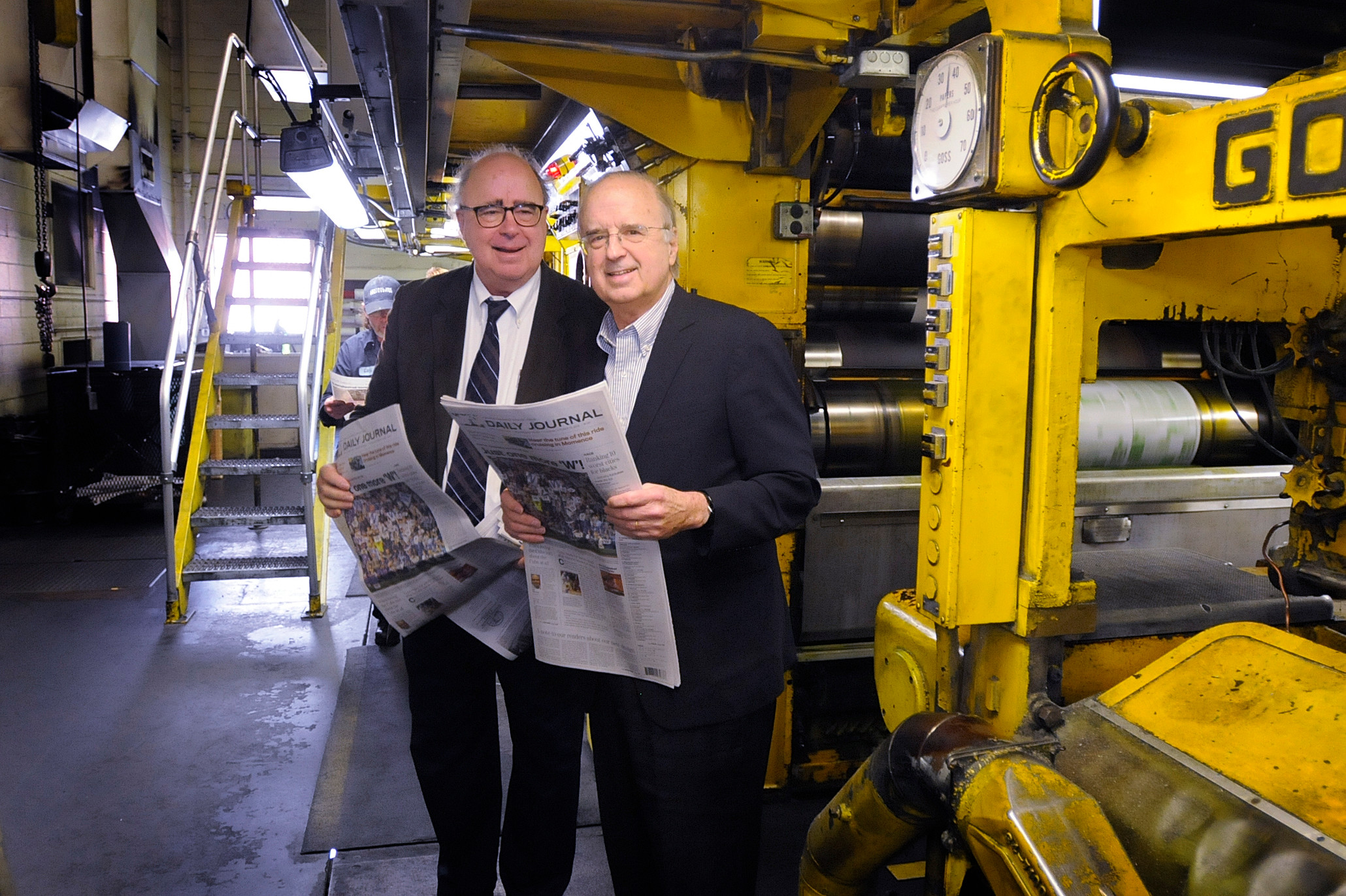 Tom and Rob Small get their first look at the redesign of the (Kankakee, Ill.) Daily Journal in the press room of launch day.