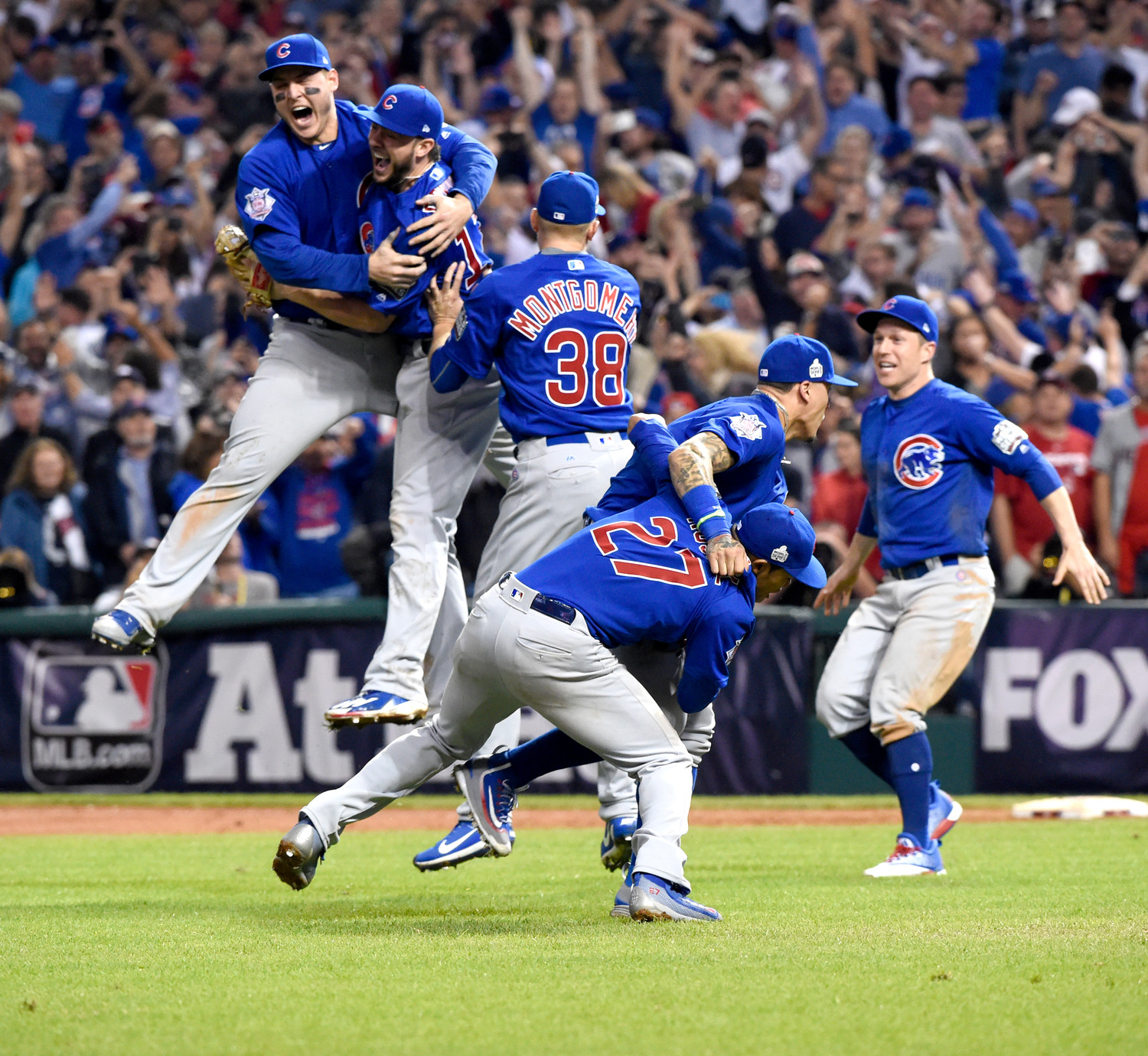 The Chicago Cubs celebrate their win during Game 7 of baseball