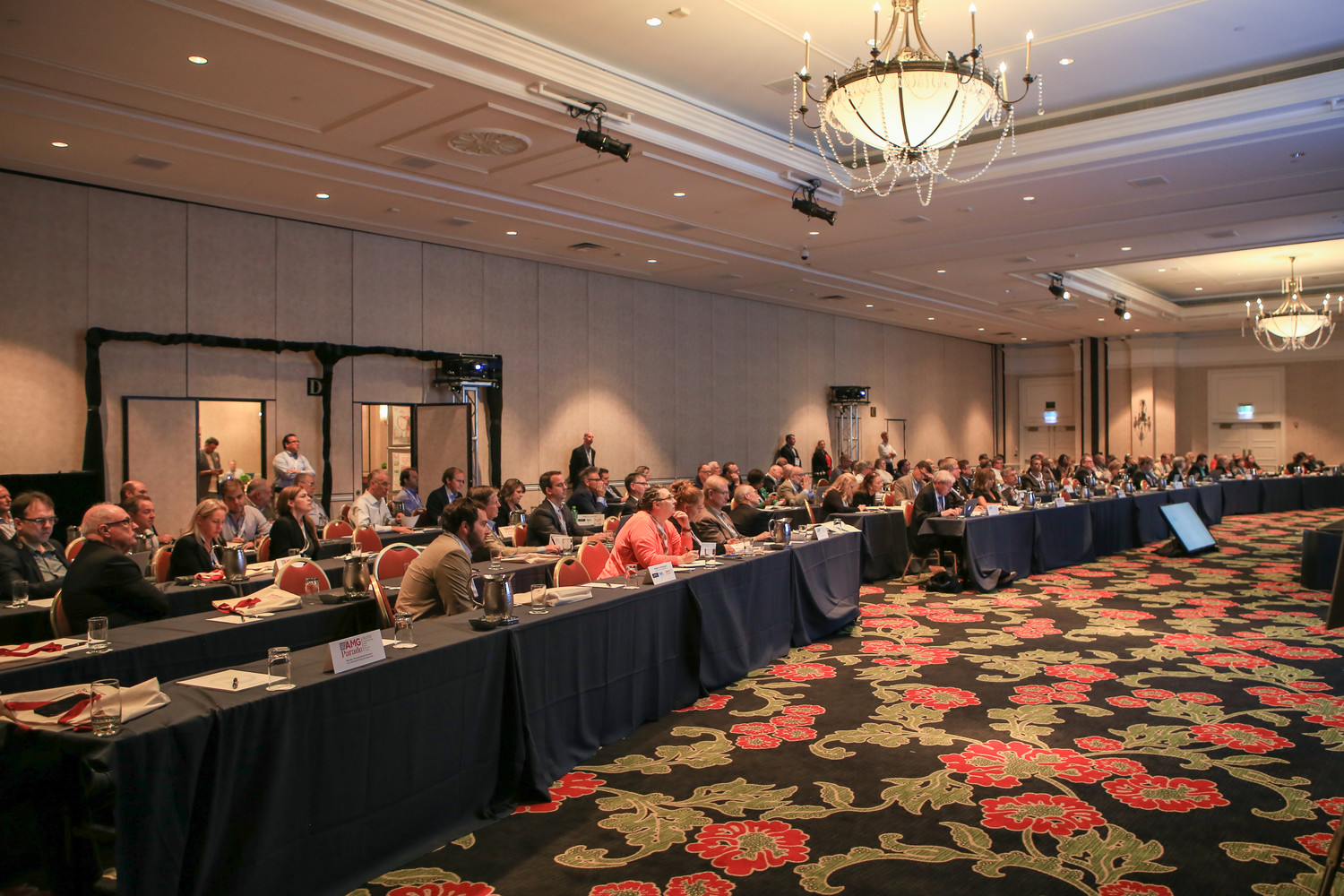 The first-ever joint Annual Meeting of Inland and the Southern Newspaper Publishers Association attracted a large and attentive audience, seen here gathering for the opening session.