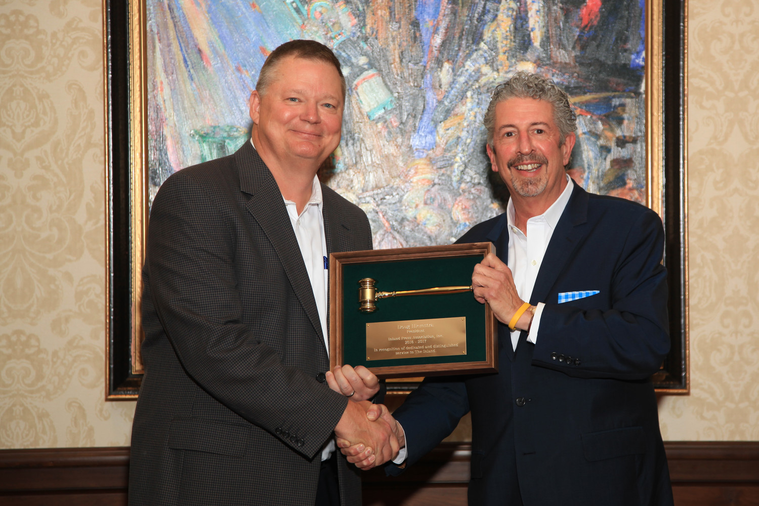 In a ceremonial passing of the gavel from the outgoing president, Doug Hiemstra, left, 