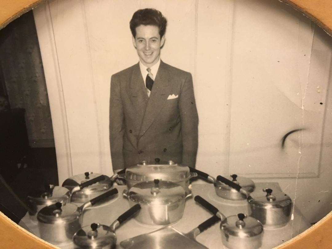 Jim Hart's father, Jack, is shown with the pots and pans he sold when he came home from being a pilot in World War II. He sold a set to the general manager of a car dealership—and the next week he began his long career selling automobiles.