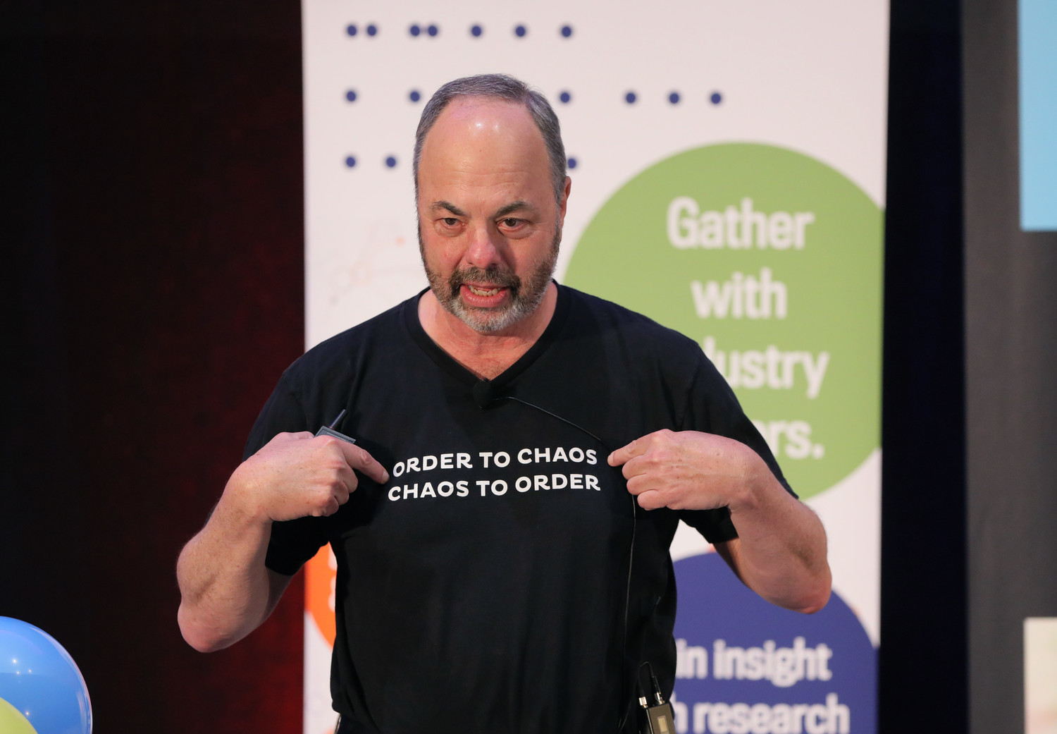 "Media analyst Ken Doctor delivered the keynote address at the Mega-Conference wearing a T-shirt with the phrase ""Order to chaos. Chaos to order."""