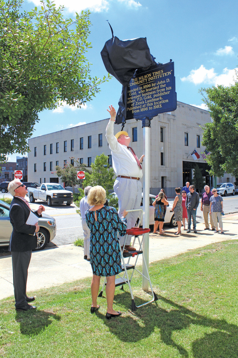 Wilson County Historical Association President Perry Morrison unveils a historical marker on Goldsboro Street near The Wilson Times' former home Wednesday afternoon. Drew C. Wilson | Times