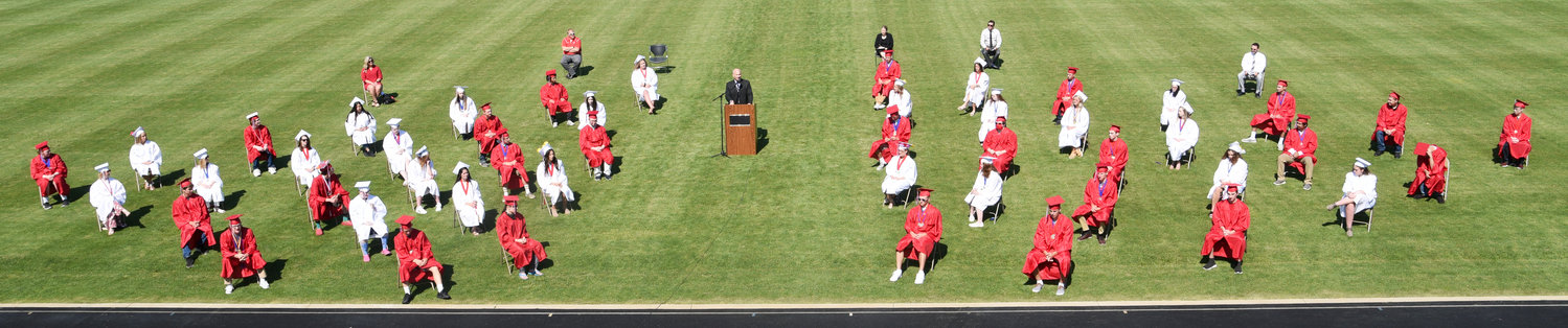 Highland administrators took precautions to prevent the spread of COVID-19 by spreading out graduates on the high school football field.