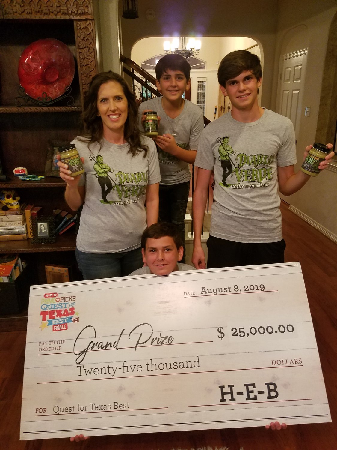 Traci, George, Aydin and Luke Johansson won grand prize in H-E-B's Quest for Texas Best food competition.