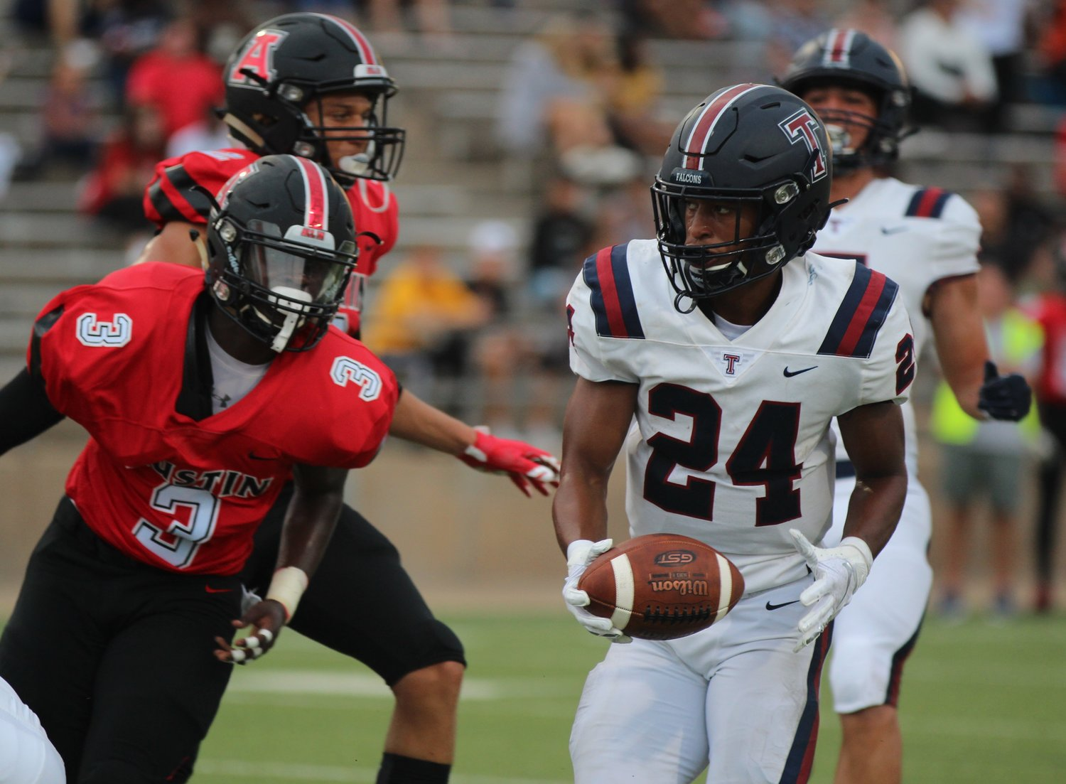 Tompkins' R.J. Smith carries the ball during a game against Fort Bend Austin on Aug. 31 at Mercer Stadium.