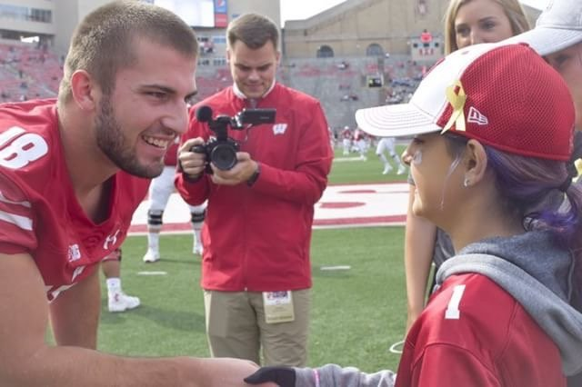 Former Katy High star and Wisconsin junior safety Collin Wilder is shown with 11-year-old Aubrey Wayman. The two were introduced during a game last September for Childhood Cancer Awareness Month and have maintained a friendly relationship since.