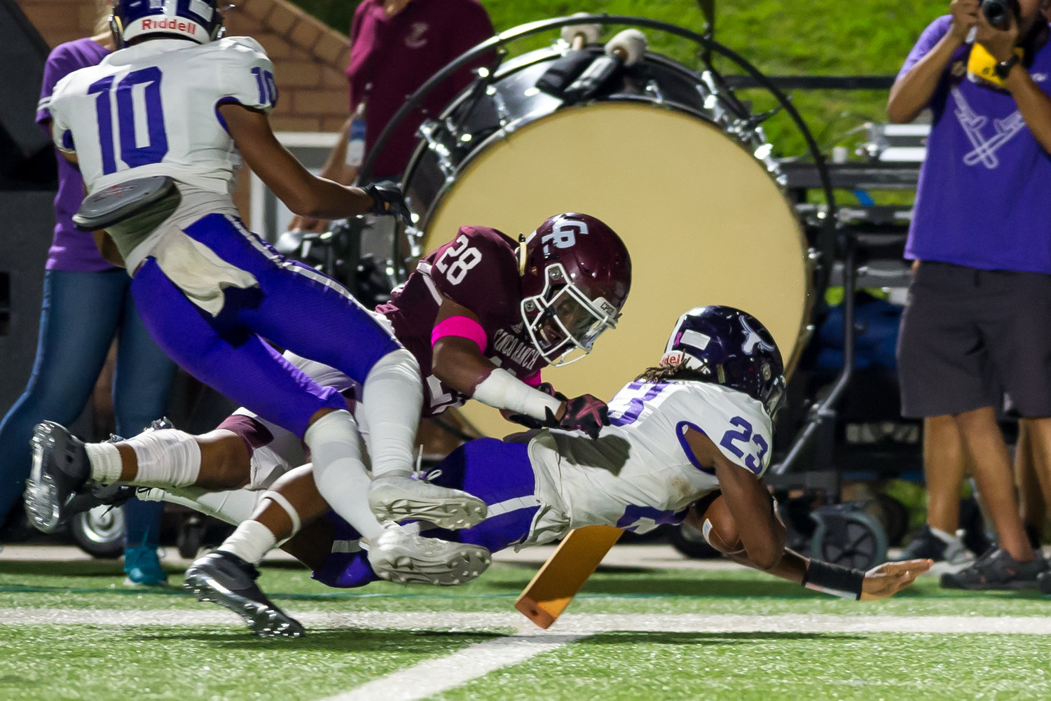 Morton Ranch junior quarterback Jaymarcus Wilson (23) dives for the pylon to score a touchdown during a game against Cinco Ranch on Oct. 4 at Legacy Stadium.
