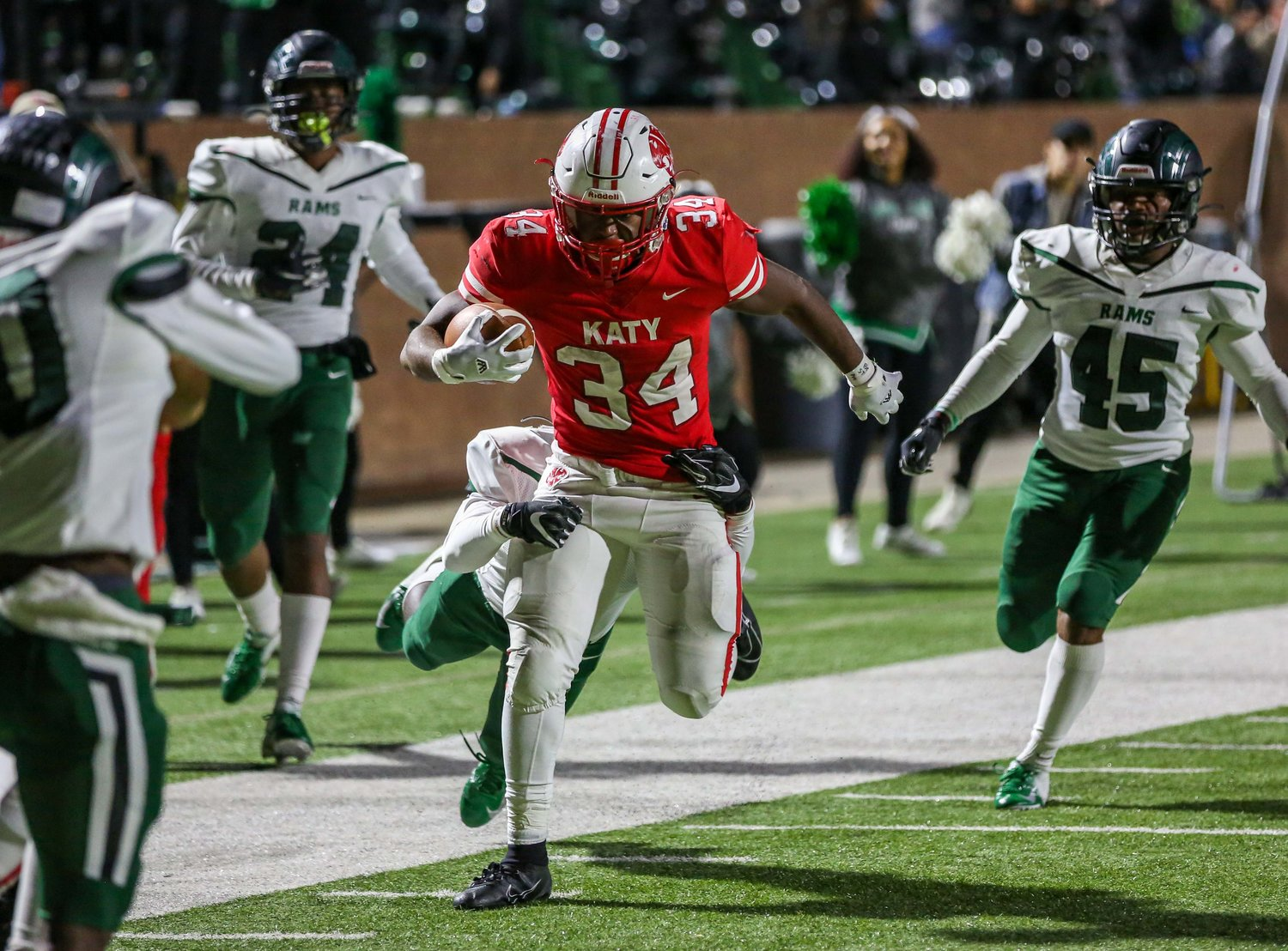 Katy, Tx. Nov. 1, 2019: Katy's Ronald Hoff (34) carries the ball scoring a TD during a conference game between Katy Tigers and Mayde Creek Rams at Rhodes Stadium. (Photo by Mark Goodman / Katy Times)