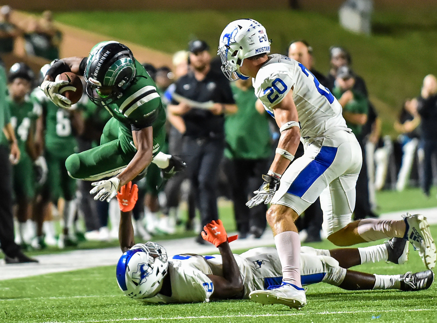 Katy, Tx. Oct. 18, 2019: Mayde Creek's Jacoby Wilson (8) carries the ball picking up the first down during a conference game between Katy Taylor Mustangs and Mayde Creek Rams at Rhodes Stadium. (Photo by Mark Goodman / Katy Times)
