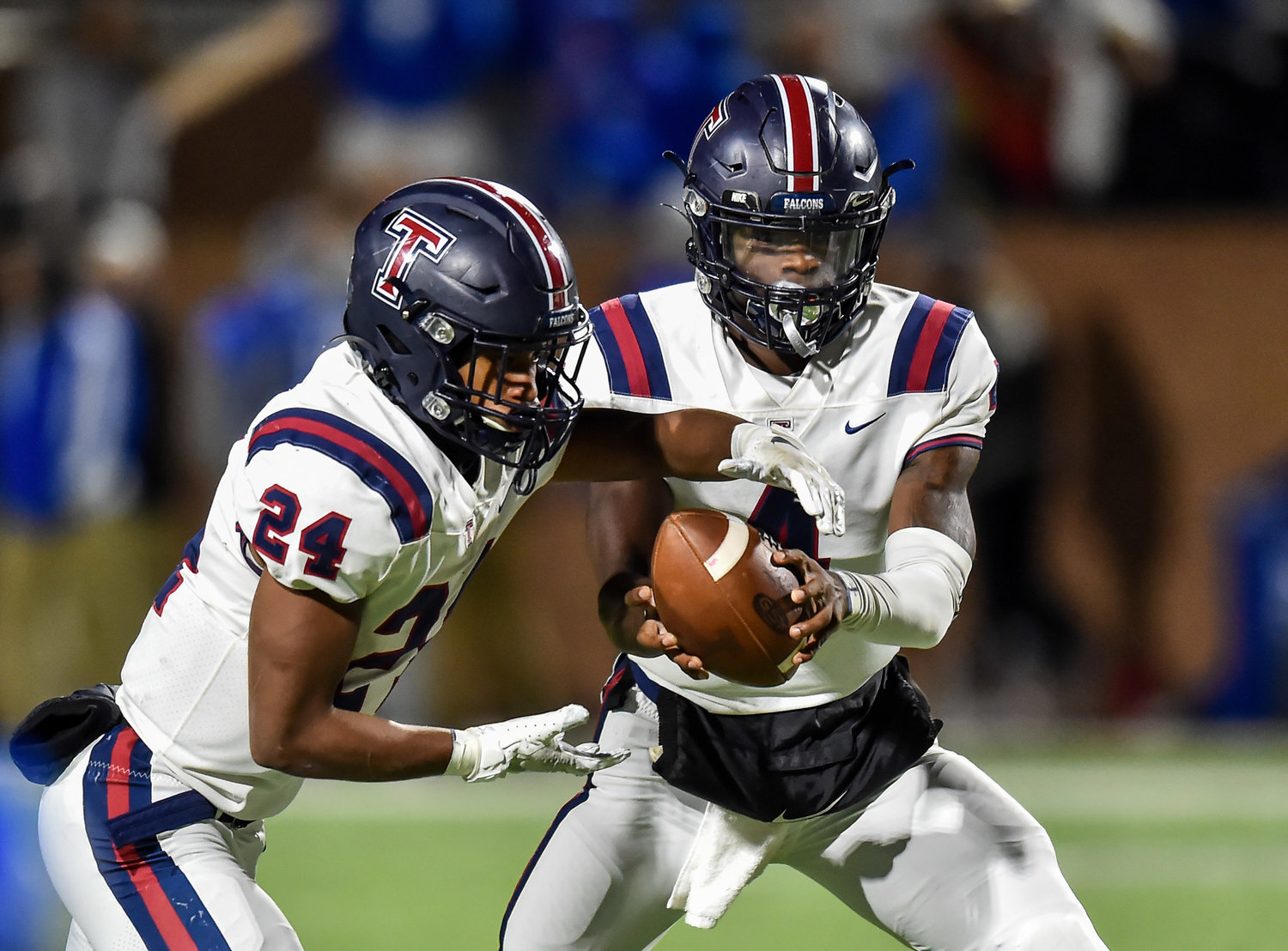 Katy, Tx. Oct. 25, 2019: Tompkins QB Jalen Milroe (4) hands the ball off to Tompkins R.j. Smith (24) during a game between Taylor Mustangs and Tompkins Falcons at Rhodes Stadium in Katy. (Photo by Mark Goodman / Katy Times)