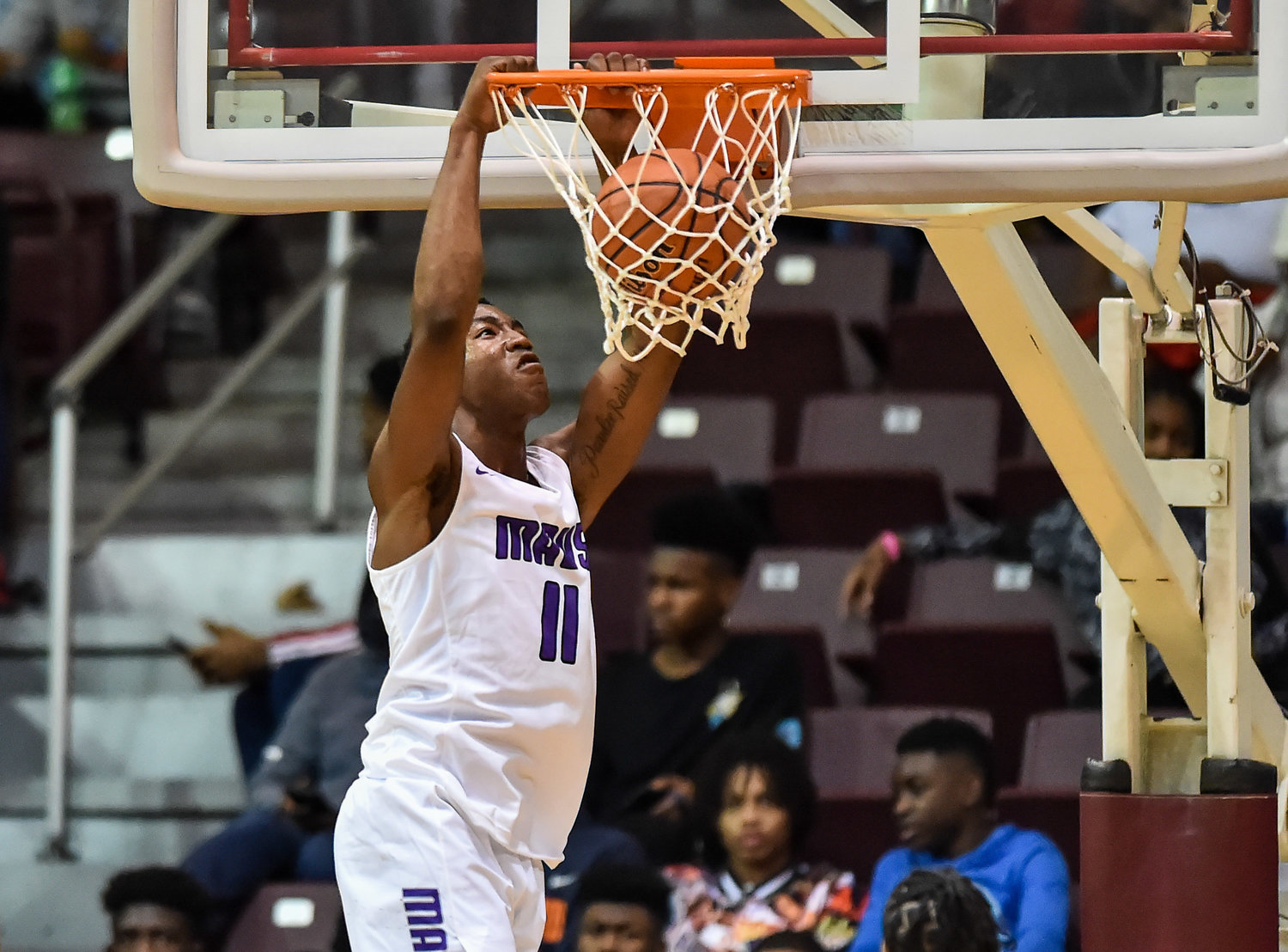 "Houston Tx. Nov. 16, 2019: Morton Ranch's Adrian Caldwell (11) gets the slam dunk during the RCS Sports ""Season Opener"" at M.O. Campbell Center.  (Photo by Mark Goodman / Katy Times)"