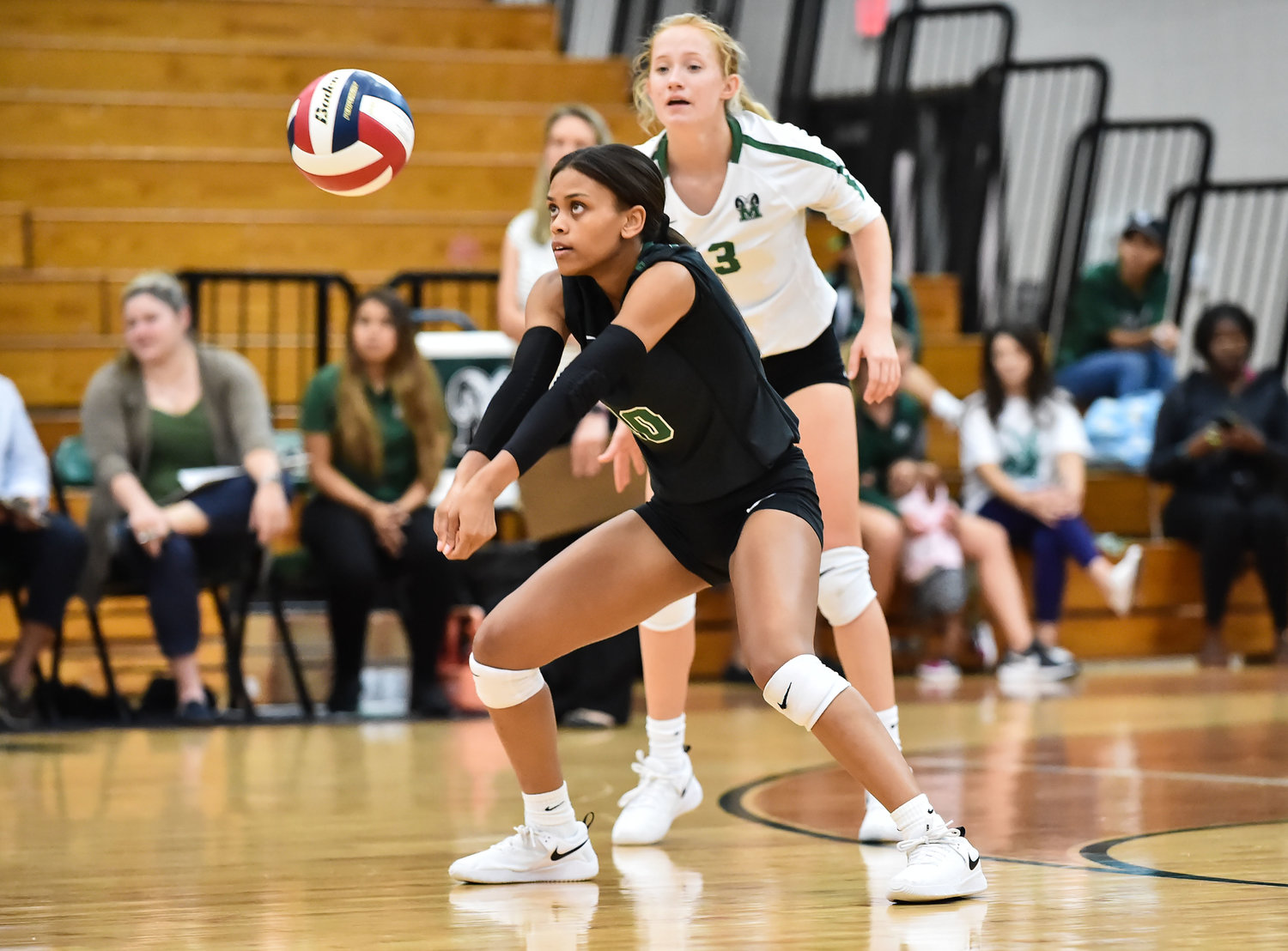 Katy, Tx Sept 3, 2019: Mayde Creek's Jade Smith (10) returns the ball as Mayde Creek's Katie Griese (13) looks on during a game with Westfield at MCHS. (Photo by Mark Goodman - Katy Times