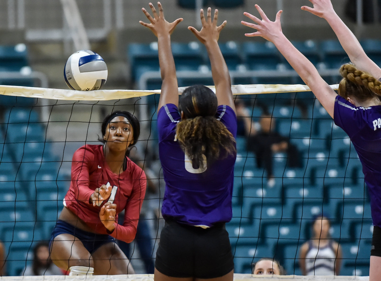 Katy Tx. Nov.5, 2019: Tompkins Cindy Tchouangwa (11) delivers a shot past Ridge Points Randee Hennings (6) during a high school volleyball playoff match between Tompkins and Ridge Point at the Merrell Center in Katy. (Photo by Mark Goodman / Katy Times)