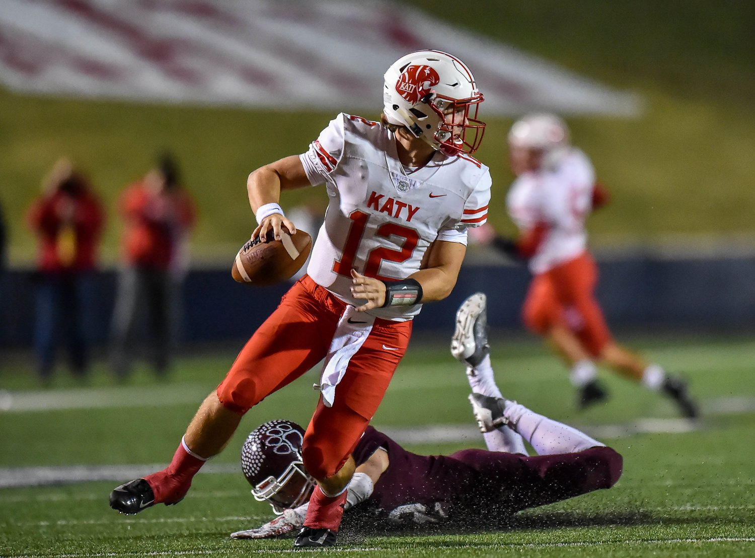 Houston, Tx. Nov. 22, 2019: Katy's QB Bronson McClelland (12) avoids the sack during the area playoff game between Katy Tigers and Cy-Fair Bobcats at Tully Stadium. (Photo by Mark Goodman / Katy Times)