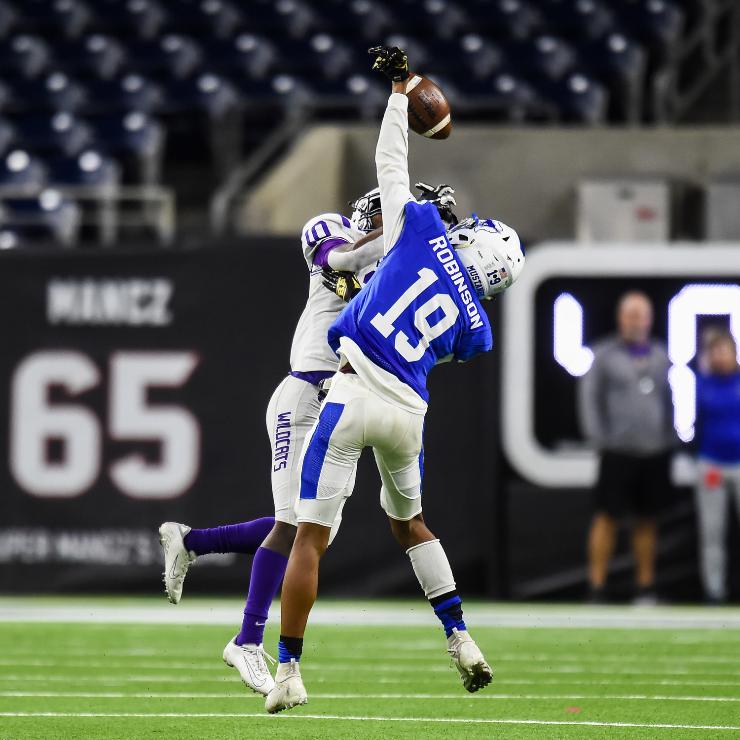 Houston, Tx. Nov. 30, 2019: Taylor's Hollis Robinson (19) breaks up a pass intended for Humbles Donald Harper (10) during the regional semifinal playoff game between Katy Taylor and Humble at NRG Stadium in Houston. (Photo by Mark Goodman / Katy Times)
