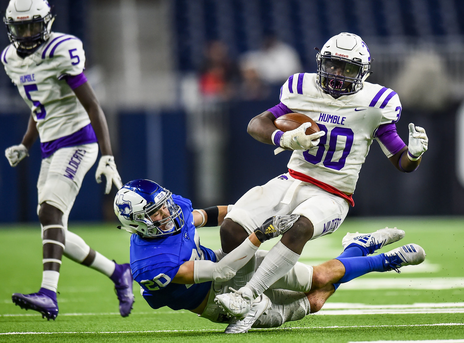 Houston, Tx. Nov. 30, 2019: Taylor's Adel Barbarawi (30) makes the stop on Humbles X'zavier Sidney (30) during the regional semifinal playoff game between Katy Taylor and Humble at NRG Stadium in Houston. (Photo by Mark Goodman / Katy Times)