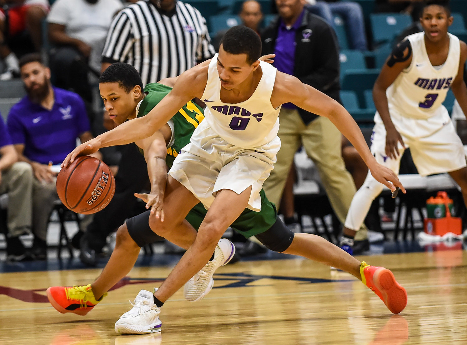 Katy Tx. Dec7, 2019: Morton Ranch's Westley Sellers (0) dribbles away at Klein Forest's Darius Solomon (13) reached in on a steal attempt during the Katy Classic at the Merrell Center.  (Photo by Mark Goodman / Katy Times)