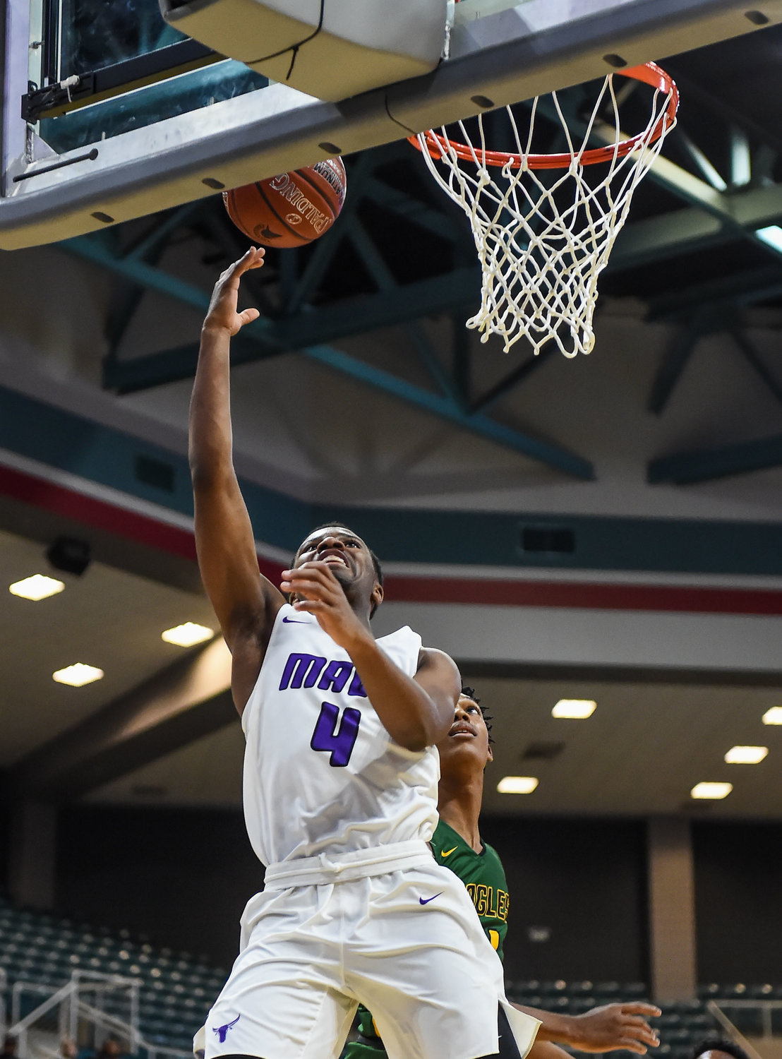 Katy Tx. Dec7, 2019: Morton Ranch's LJ Cryer (4) drives to the basket scoring during the Katy Classic at the Merrell Center.  (Photo by Mark Goodman / Katy Times)