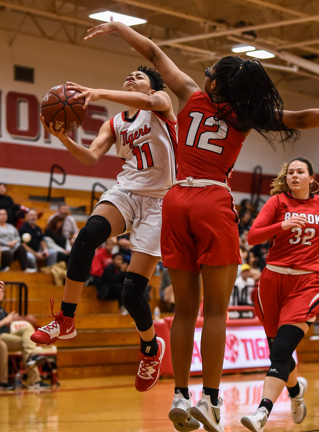 Katy Tx. Dec. 10, 2019: Katy's Allana Thompson (11) drives up the lane to the basket guarded by Clear Brooks Hailey Henry (12) during a non-district basketball game between Katy Tigers and Clear Brook Wolverines at Katy HS.  (Photo by Mark Goodman / Katy Times)