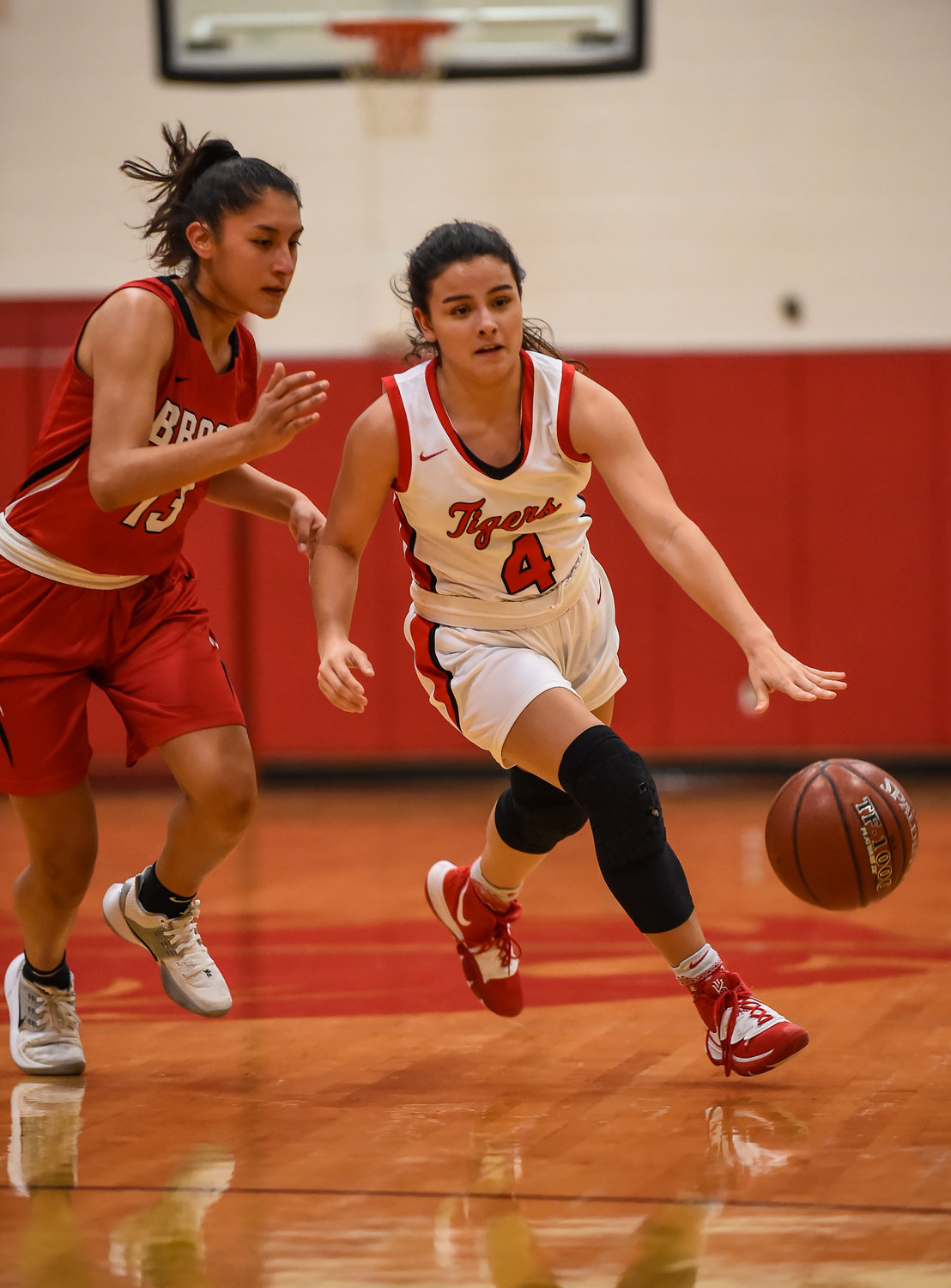 Katy Tx. Dec. 10, 2019: Katy's Sasha Fernandez (4) brings the ball up court during a non-district basketball game between Katy Tigers and Clear Brook Wolverines at Katy HS.  (Photo by Mark Goodman / Katy Times)