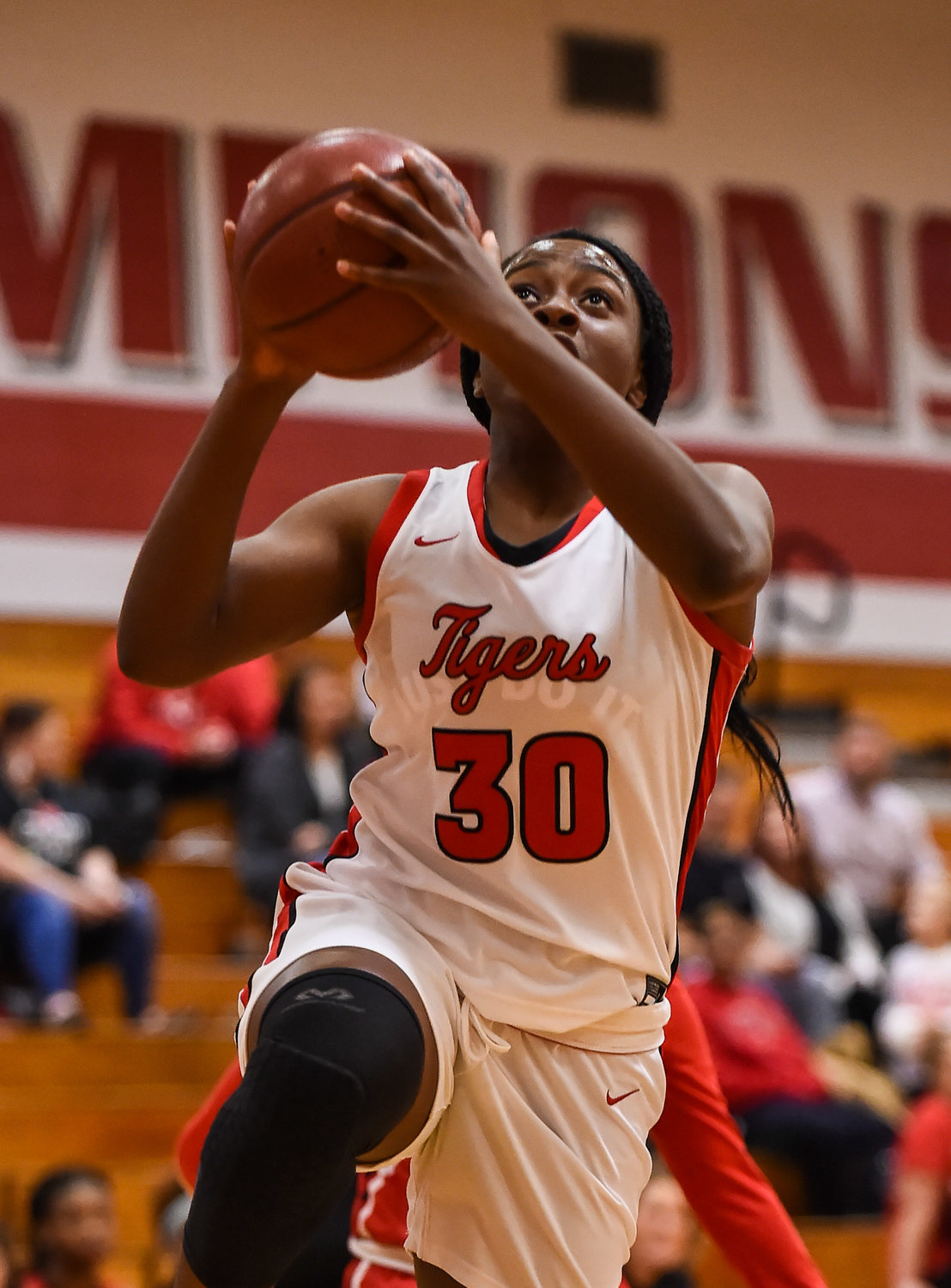 Katy Tx. Dec. 10, 2019: Katy's Joy Jegede (30) drives to the basket during a non-district basketball game between Katy Tigers and Clear Brook Wolverines at Katy HS.  (Photo by Mark Goodman / Katy Times)