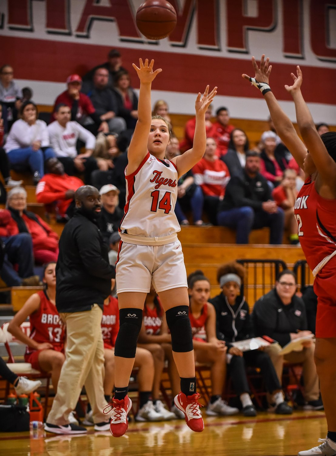 Katy Tx. Dec. 10, 2019: Katy's Darcy Swanson (14) attempts the three point shot during a non-district basketball game between Katy Tigers and Clear Brook Wolverines at Katy HS.  (Photo by Mark Goodman / Katy Times)