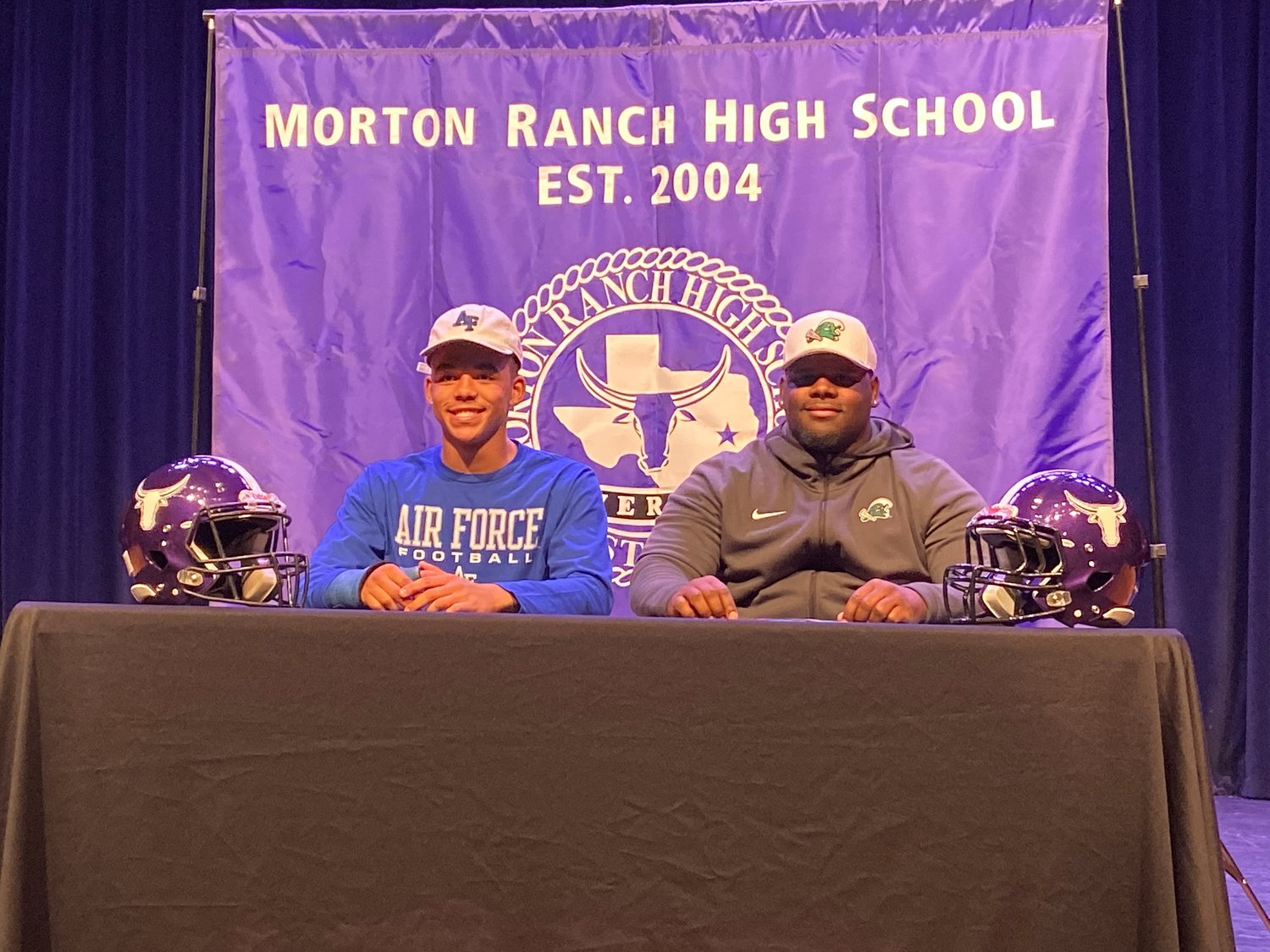 Morton Ranch defensive standouts Dorian Maynard, left, and Brandon Brown, right, pose for a photo after signing with the Air Force Academy and Tulane, respectively, on Early Signing Day on Wednesday, Dec. 18, at Morton Ranch High.