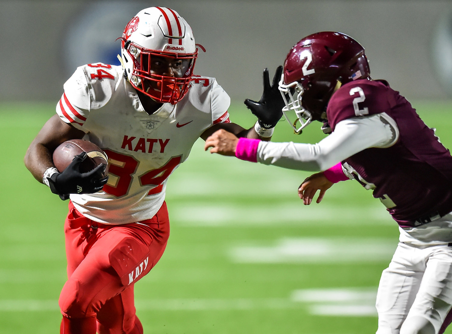 Katy, Tx. Oct. 25, 2019: Katy's Ronald Hoff (34) carries the ball as Cinco Ranch's Carson King (2) attempts to make the stop during a conference game between Katy Tigers and Cinco Ranch Cougars at Legacy Stadium. (Photo by Mark Goodman / Katy Times)