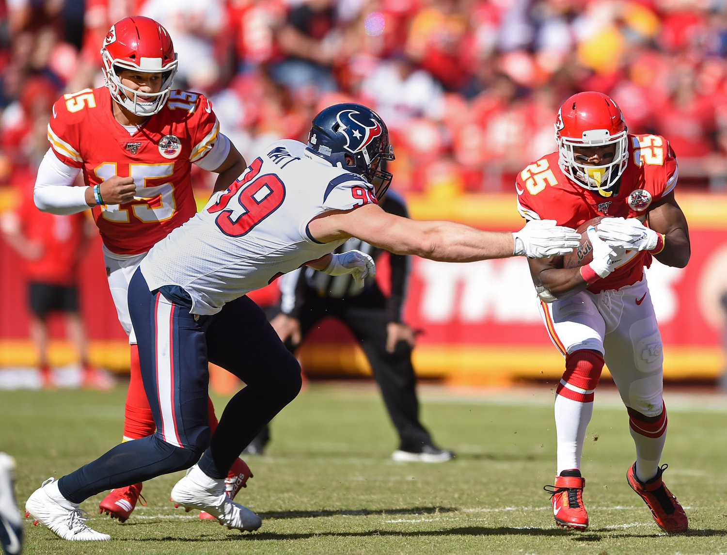 Kansas City Chiefs quarterback Patrick Mahomes had a handoff to Chiefs running back LeSean McCoy (25) as Texans defensive end J.J. Watt (99) went after McCoy during the second half of game action Sunday, Oct. 13, 2019, at Arrowhead Stadium. (Tammy Ljungblad/Kansas City Star/TNS)