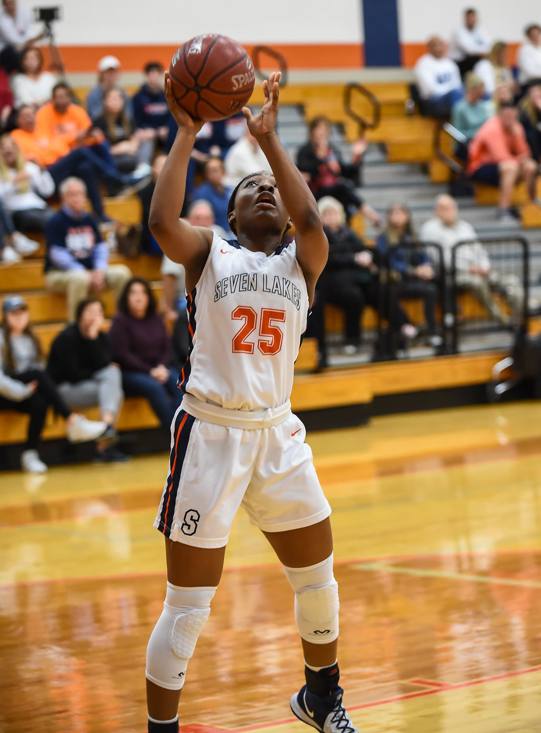 Katy Tx. Jan. 7, 2020: Seven Lakes Ib Afolabi (25) gets under the basket as she goes up for the shot during district basketball game between Katy Tigers and Seven Lakes Spartans at Seven Lakes HS.  (Photo by Mark Goodman / Katy Times)