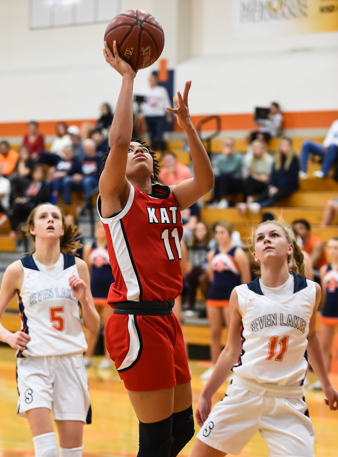 Katy Tx. Jan. 7, 2020: Katy's Allana Thompson (11) gets under the basket as she goes up for the shot during district basketball game between Katy Tigers and Seven Lakes Spartans at Seven Lakes HS.  (Photo by Mark Goodman / Katy Times)
