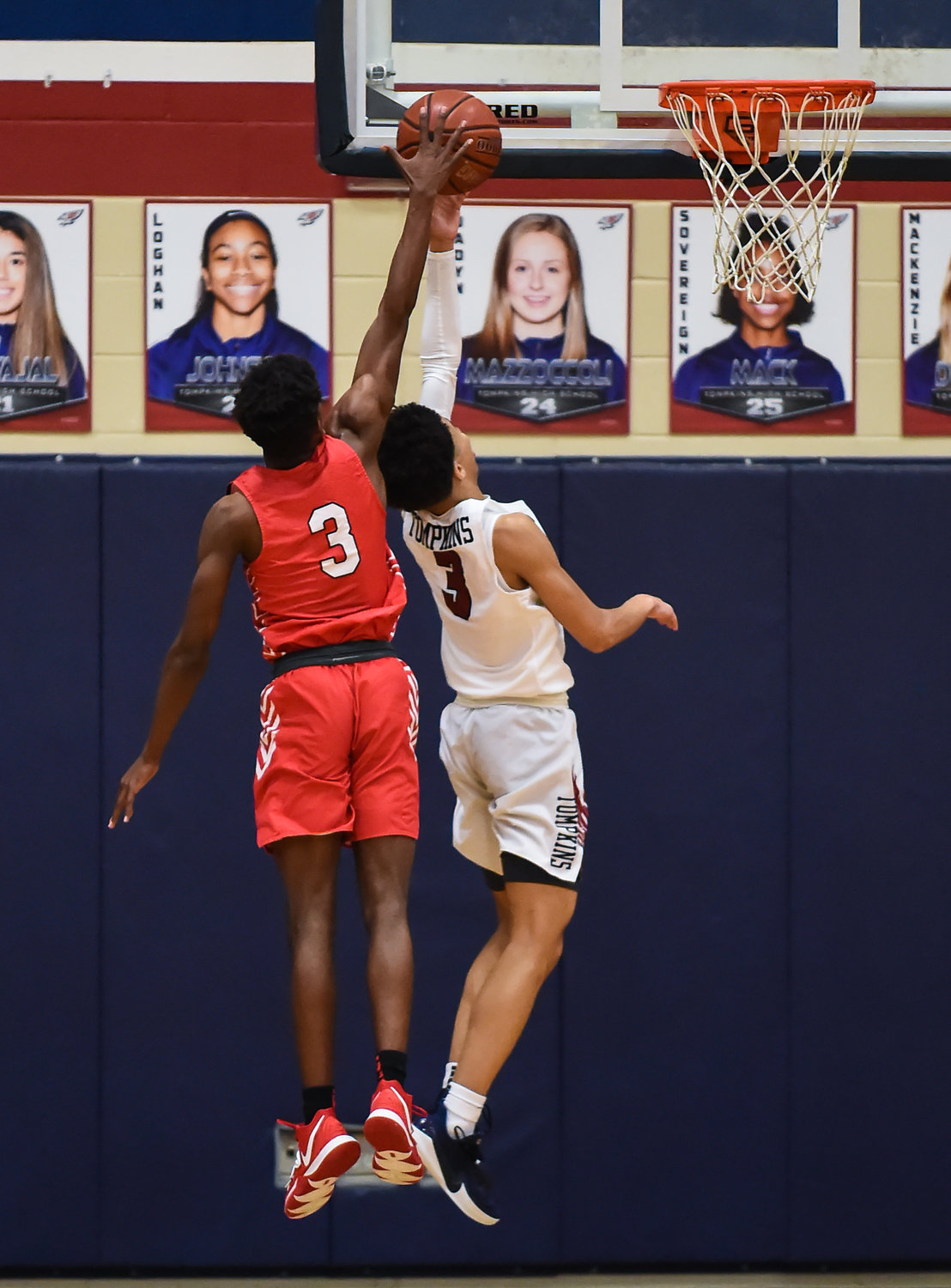 Katy Tx. Jan. 10, 2019: Katy's Ryon Johnson (3) goes up for the block on a shot by Tompkins Johnny Nash (3) during a district basketball game between Tompkins Falcons and Katy Tigers at Tompkins HS.  (Photo by Mark Goodman / Katy Times)