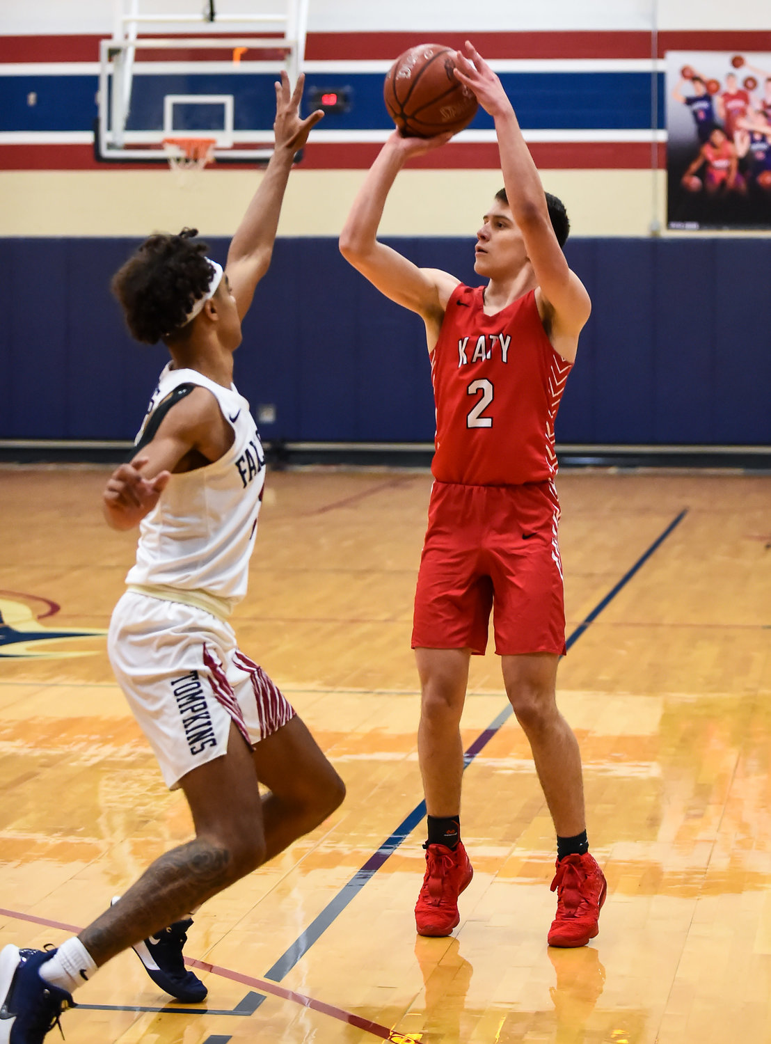 Katy Tx. Jan. 10, 2019: Katy's Bryce Purchase (2) goes up for the three point attempt during a district basketball game between Tompkins Falcons and Katy Tigers at Tompkins HS.  (Photo by Mark Goodman / Katy Times)