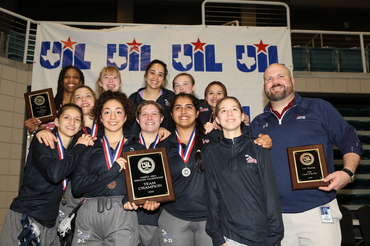 Tompkins' girls wrestling team won the program's first district title by dominating the District 9-6A championships on Feb. 8 at the Merrell Center.