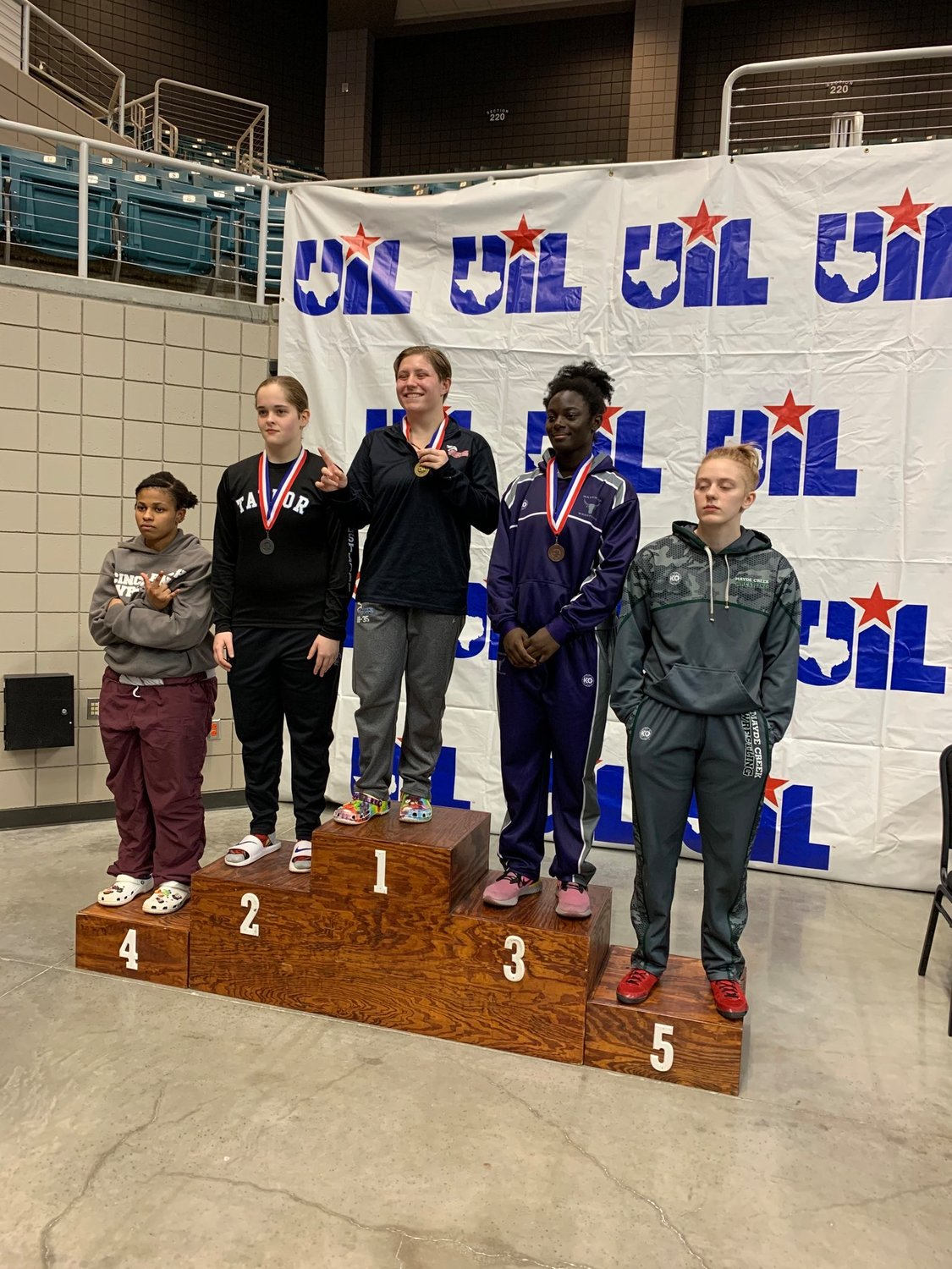 Tompkins junior Kaitlyn Bryant won first in the 165 class of the District 9-6A championships on Feb. 8 at the Merrell Center.