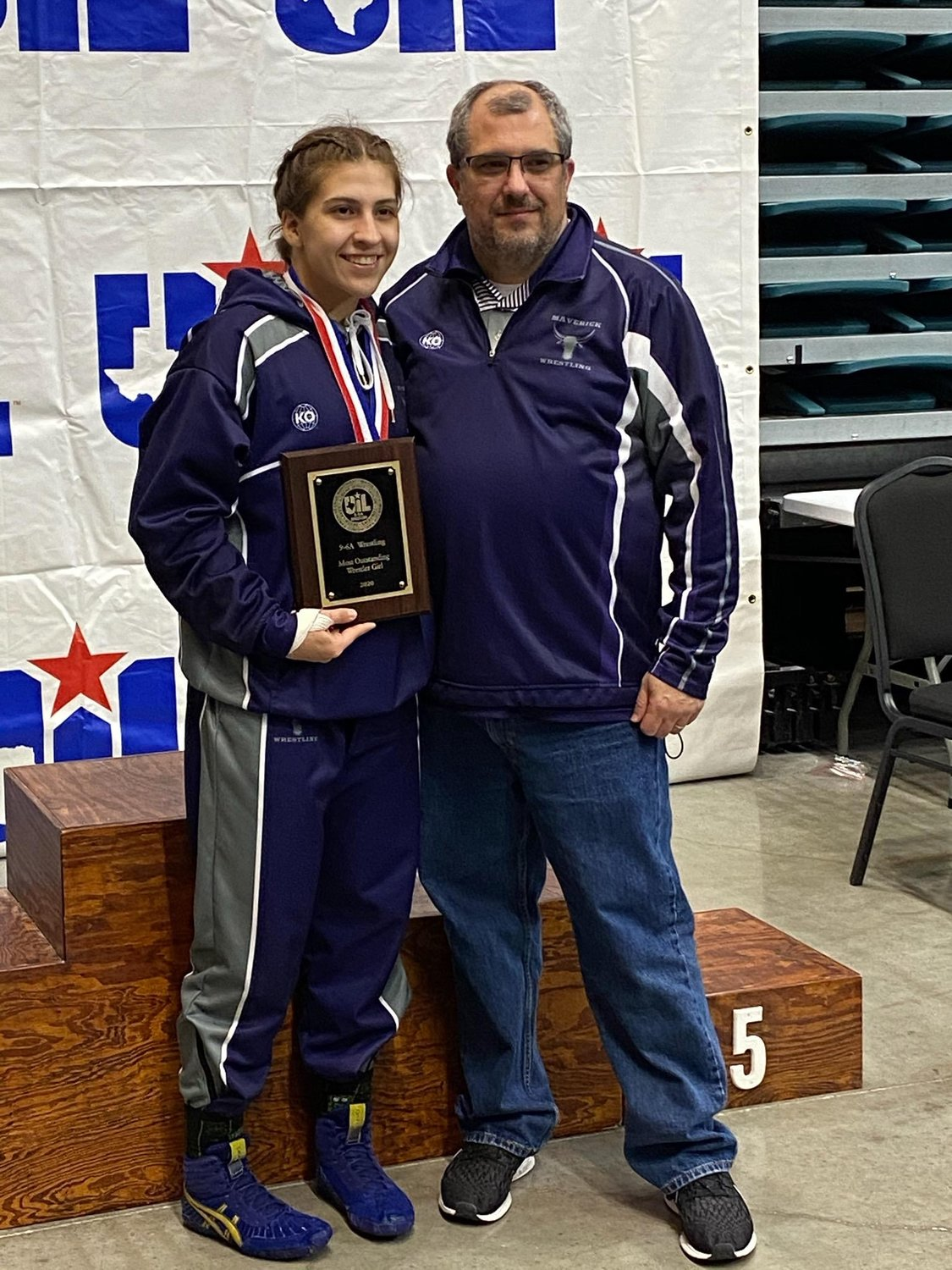 Morton Ranch senior Jordan Suarez, left, poses with coach Mark Balser after being named Most Outstanding Wrestler of the District 9-6A girls championships on Feb. 8 at the Merrell Center.