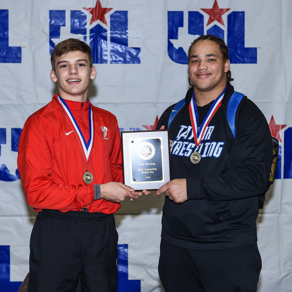Katy High senior Ty Wright and Taylor senior Curshawn Wilkins shared the Most Outstanding Wrestler honors at the District 9-6A boys championships on Feb. 7 at the Merrell Center.