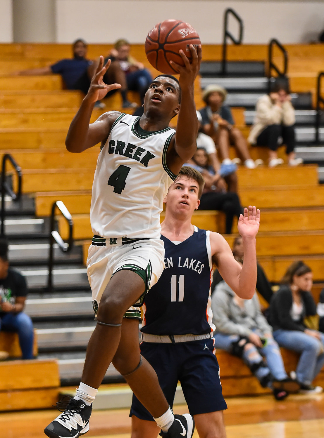 In this file photo from Jan. 14, 2020, Mayde Creek's Rommell Williams (4) drives up the lane to the basket scoring for the Rams during a district basketball game against Seven Lakes at Mayde Creek High. Williams scored a game-high 24 points for the Rams in a 45-43 win over Cinco Ranch on Feb. 21 that put Mayde Creek in the playoffs for the second straight season.