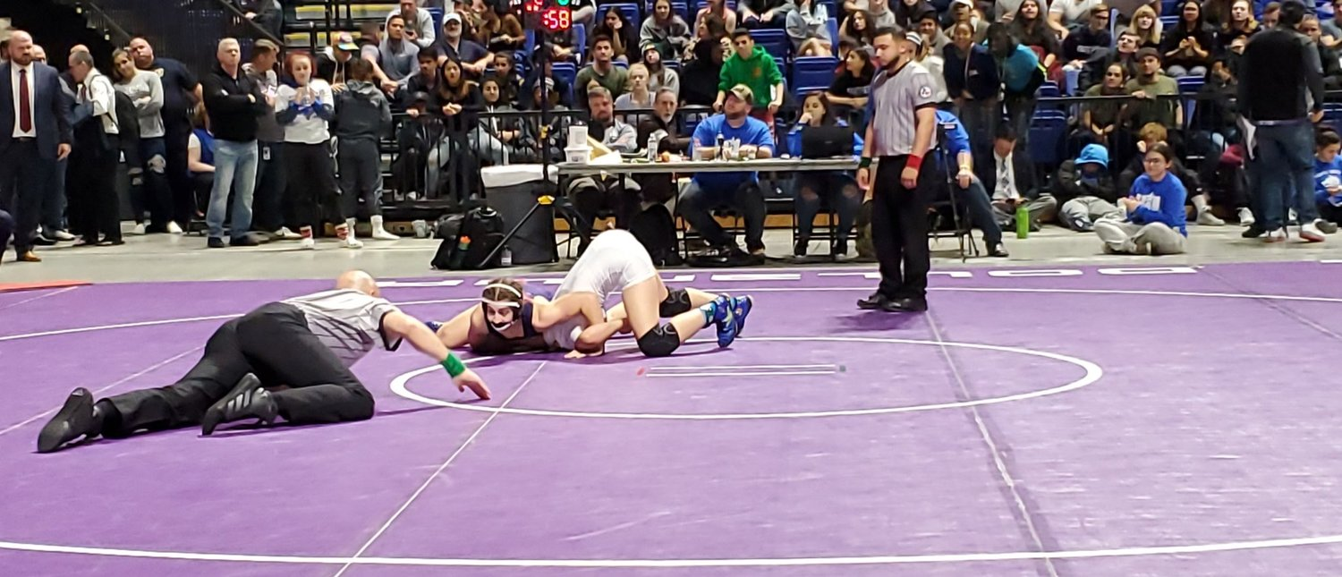 Morton Ranch senior Jordan Suarez pins Seven Lakes' Krista Garcia to win the 138-pound state championship at the UIL Class 6A wrestling tournament on Feb. 22 at the Berry Center in Cypress.