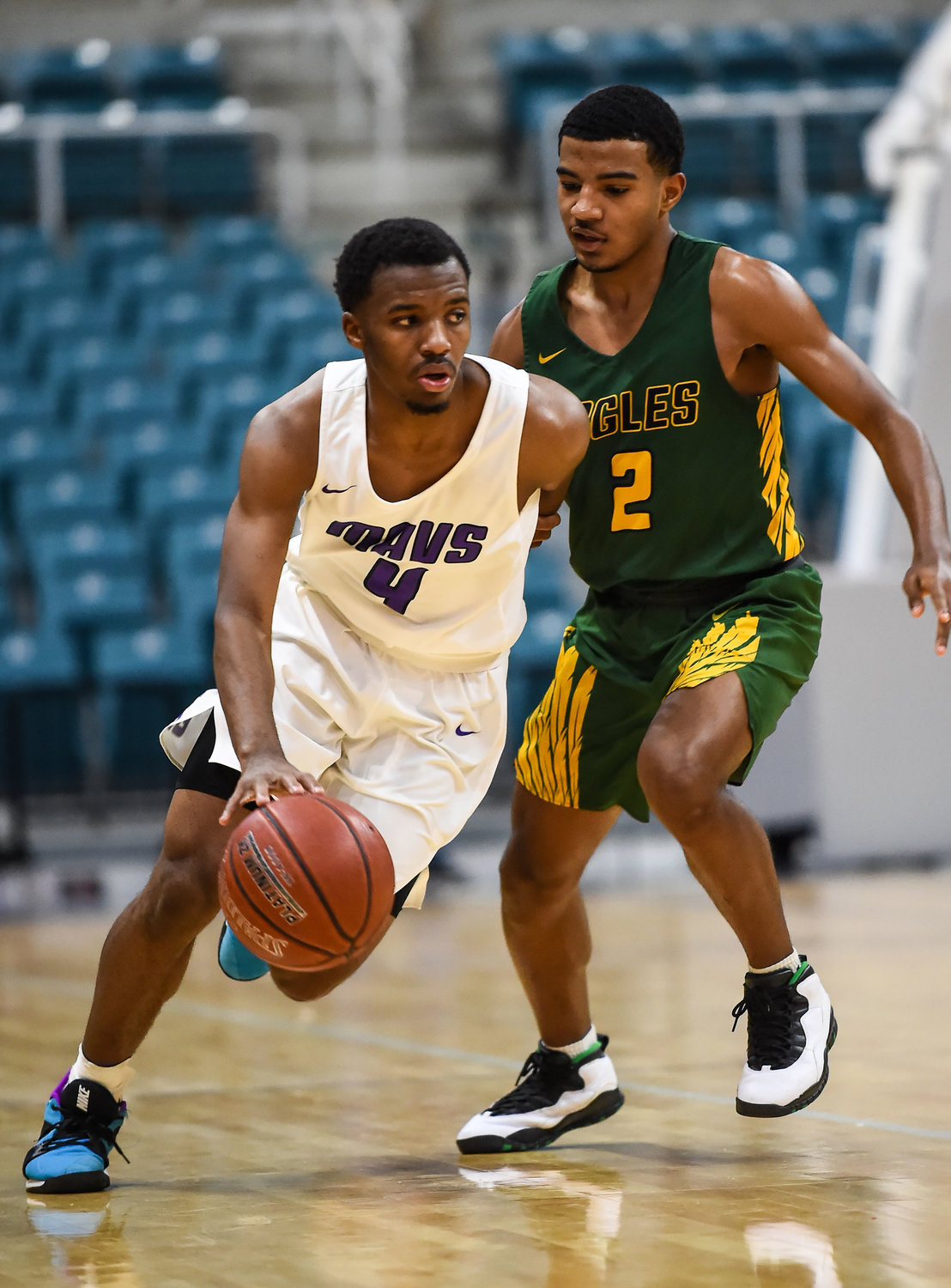 Katy Tx. Dec 7, 2019: Morton Ranch's LJ Cryer (4) drives past Klein Forest's Marion Williams (2) during the Katy Classic at the Merrell Center.  (Photo by Mark Goodman / Katy Times)