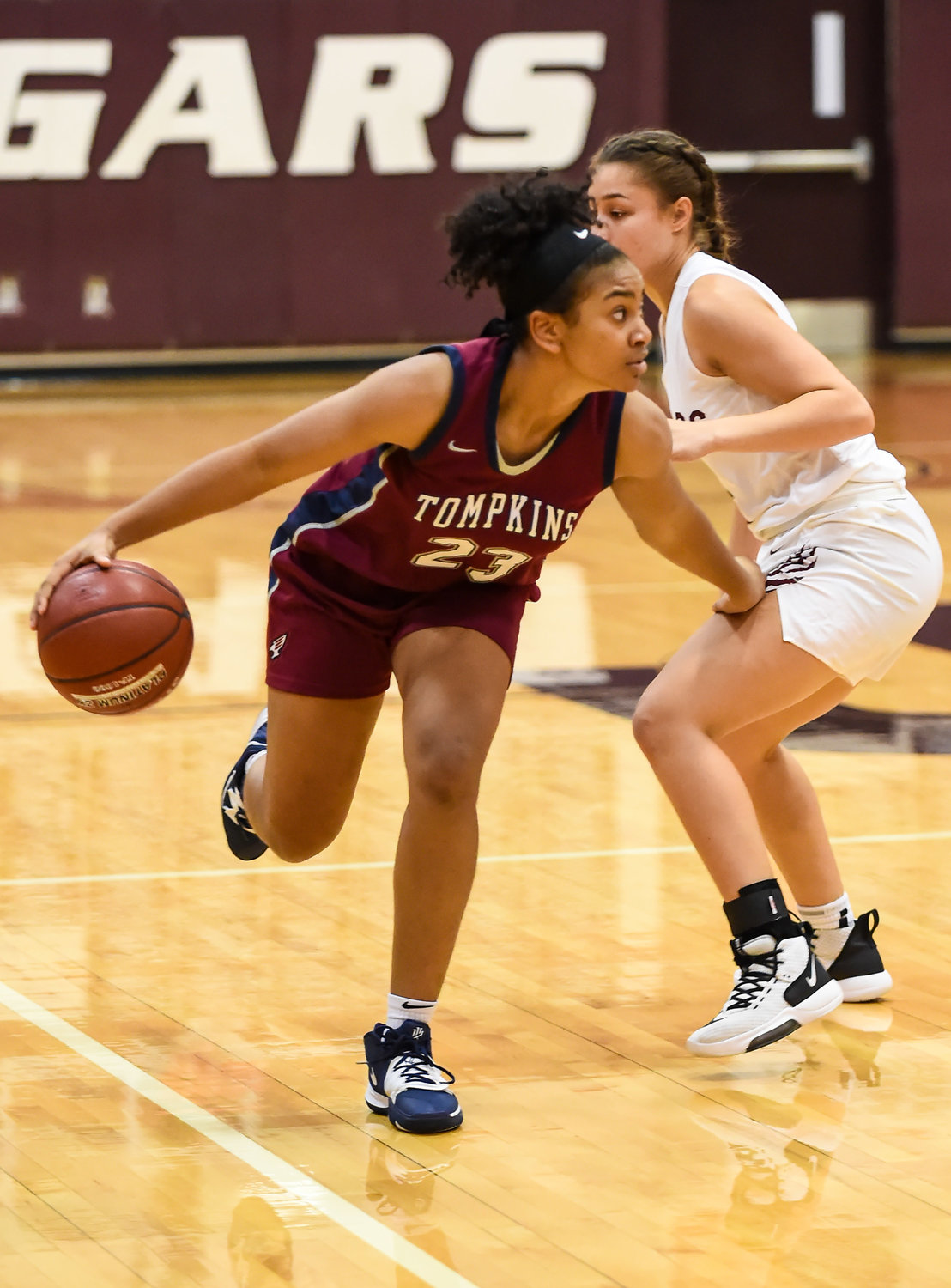 Katy Tx. Jan. 3, 2020: Tompkins' Loghan Johnson (23) brings the ball up court during district basketball game between Tompkins Falcons and Cinco Ranch Cougars at CRHS.  (Photo by Mark Goodman / Katy Times)