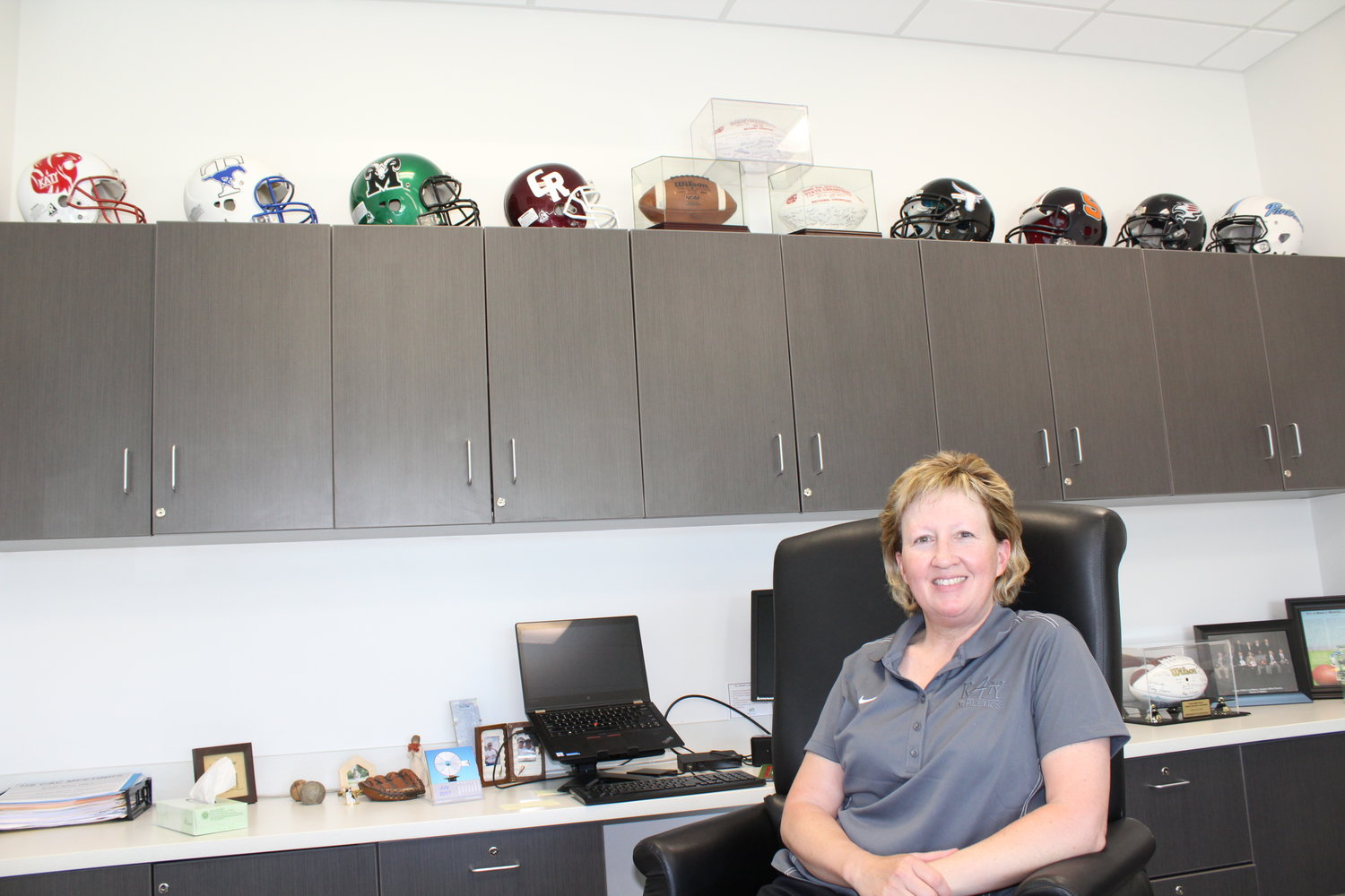 In this photo from July 2017, Katy ISD athletic director Debbie Decker poses in her office at Legacy Stadium.