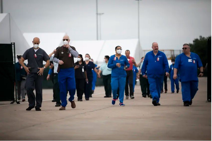 Medical personnel during a media tour of a medical shelter at NRG Park in Houston on April 11, 2020. The facility was built in less than a week for a possible overflow of COVID-19 cases in the Houston area.