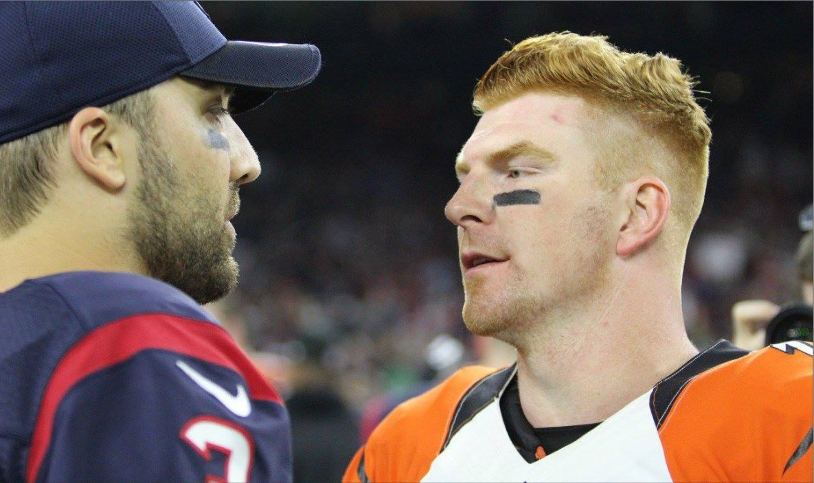NFL quarterbacks Andy Dalton (Cincinnati Bengals at the time) and Tom Savage (Houston Texans) converse after a Christmas Eve game at NRG Stadium in Houston in 2016 which the Texans won, 12-10. Dalton, the former Bengals quarterback and a Katy native, recently signed a free-agent deal to join the Dallas Cowboys.