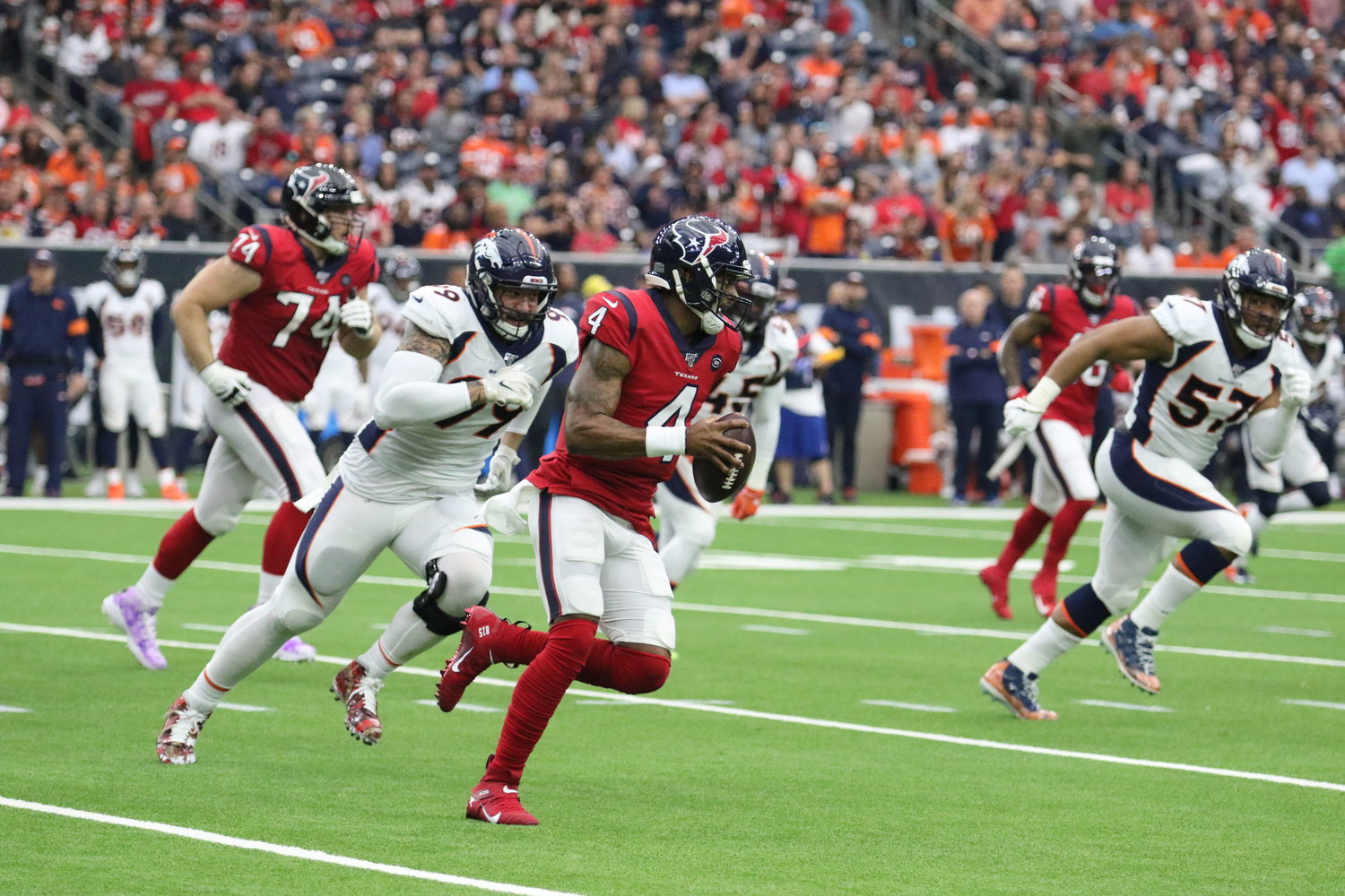 The Houston Texans' 2020 schedule was released Thursday night and features two primetime games, including a 2012 Thanksgiving rematch against the Detroit Lions. Pictured is Houston quarterback Deshaun Watson avoiding the Denver Broncos' defense in a non-conference game at NRG Stadium on Dec. 8. Denver won, 38-24.
